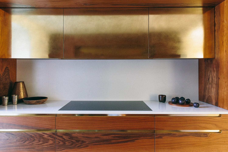 brass and walnut kitchen finish