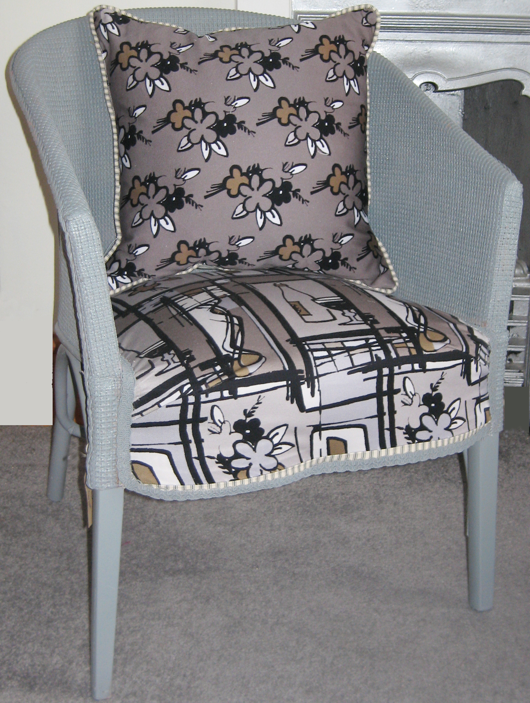 Chair covered in bottles and flowers fabrics grey