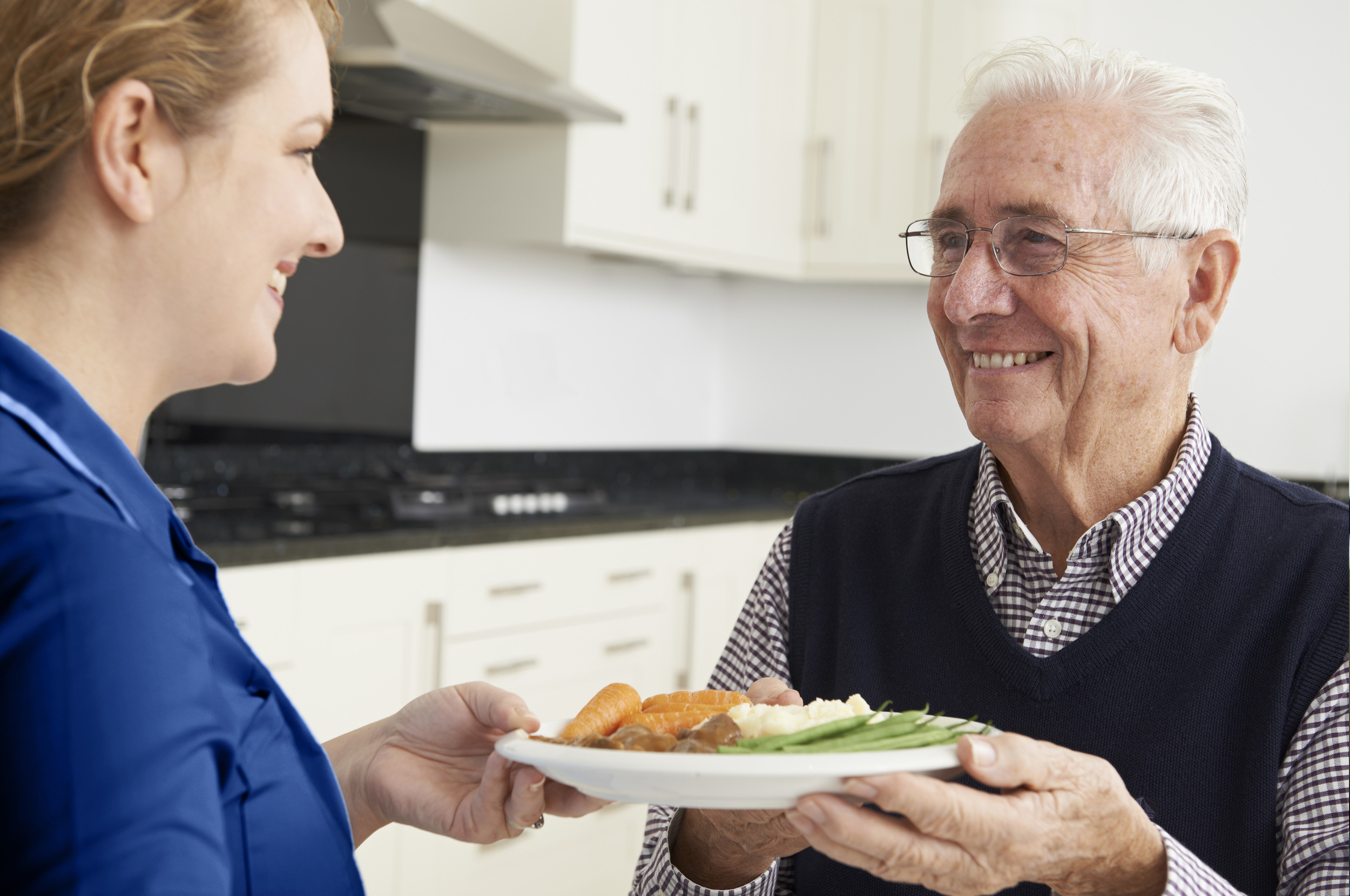 Assurance Home Care nurse helping patient cook dinner