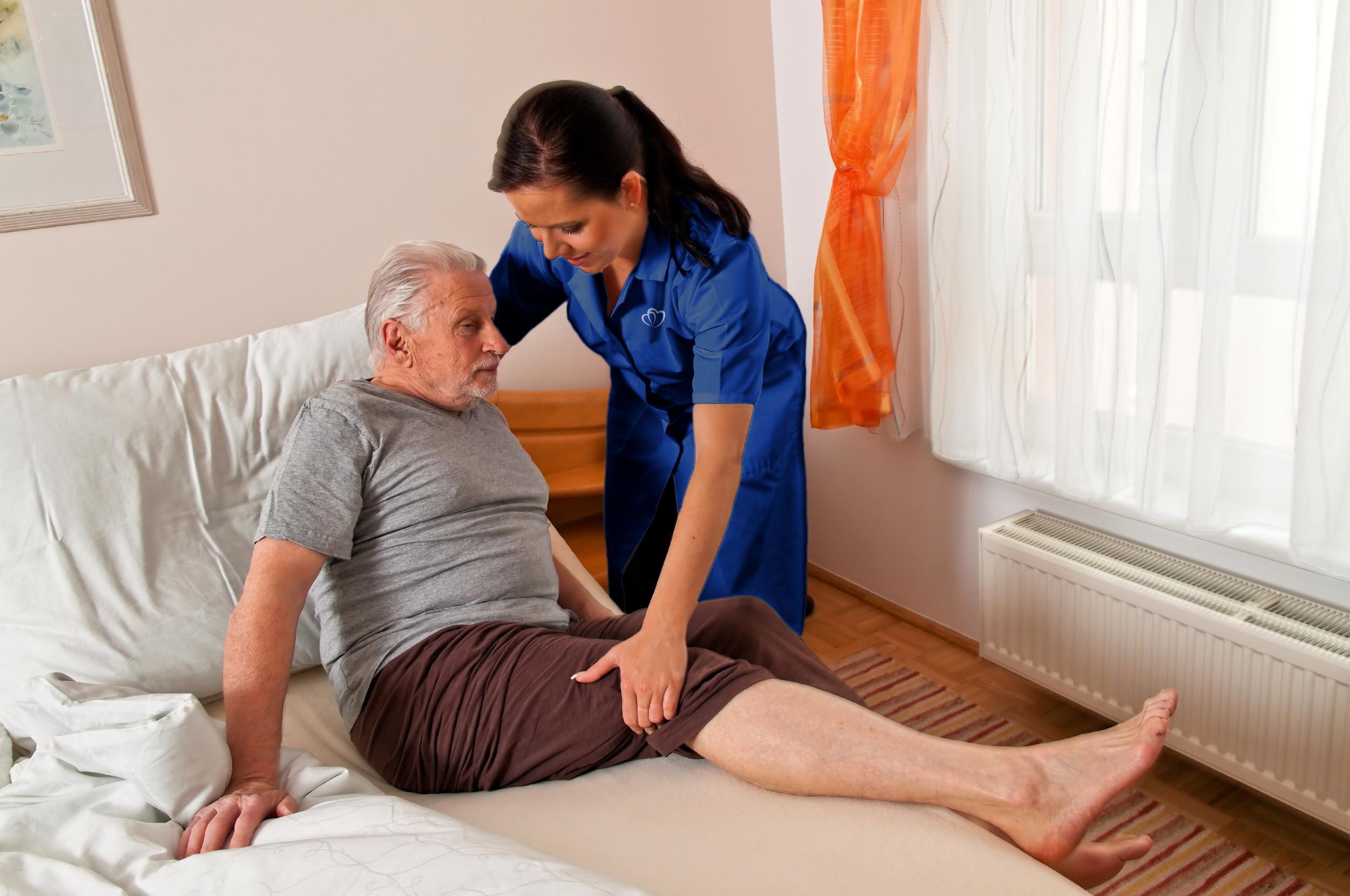Assurance Home Care nurse helping patient into bed