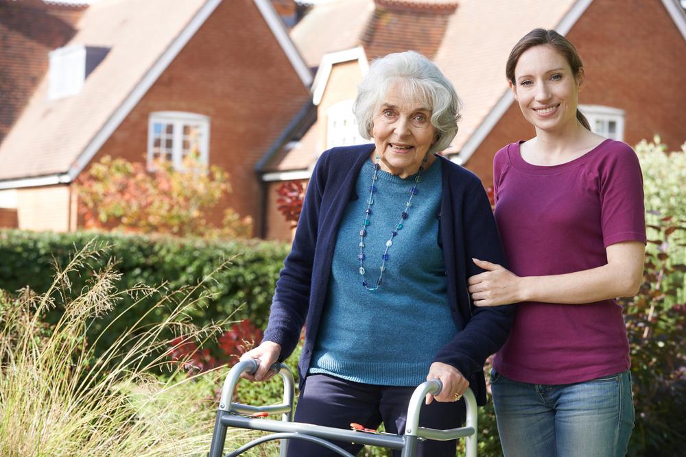 Elderly patient with her walker - posing with her daughter.