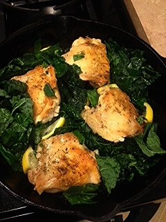 Chicken thighs & kale pre-oven. I just threw the                       kale right in the same pan. Easy!