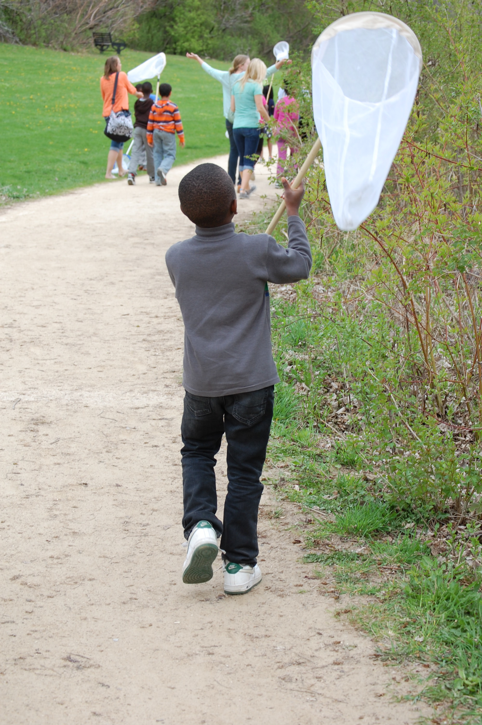 Students at Vera Court Neighborhood Center explore the nature just outside their doors during Madison Audubon's nature education programming.