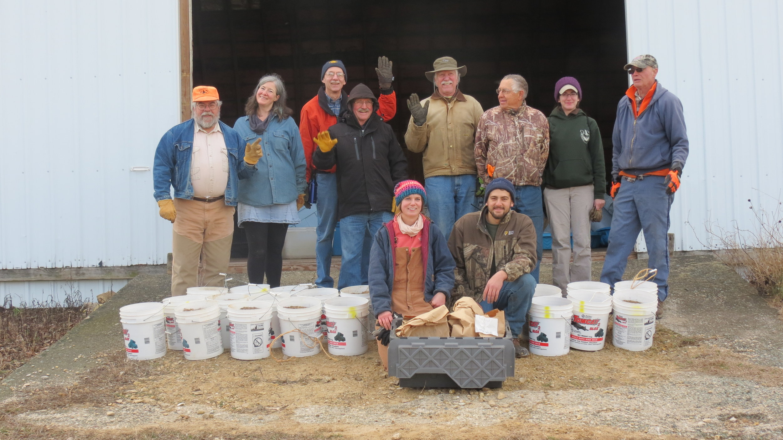 Madison Audubon volunteers help with prairie planting at Goose Pond Sanctuary. The buckets shown here are filled with native seed collected from Goose Pond earlier in the fall by volunteers, and are spread by volunteers as well!  MAS Photo