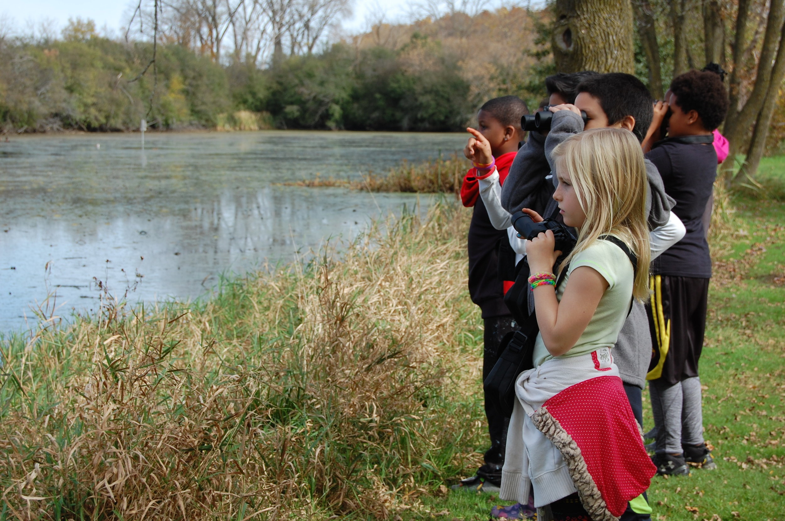 Students identify ducks during fall migration.