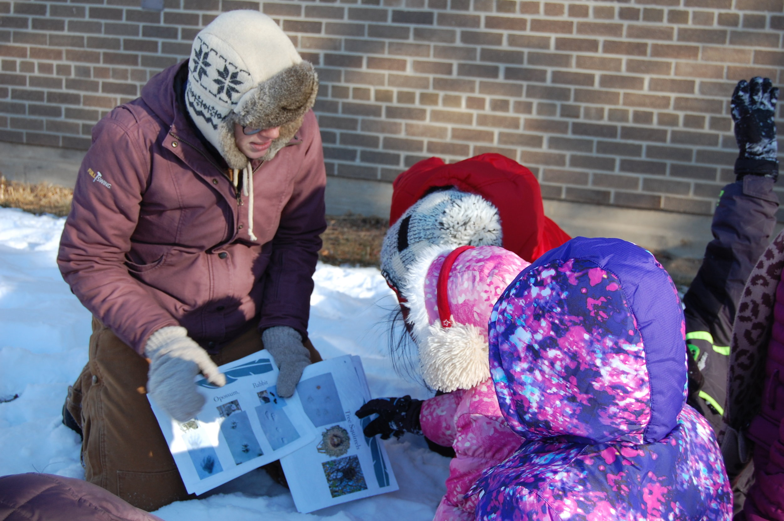 Cold weather and snow don't slow these kids down from learning animal tracks.