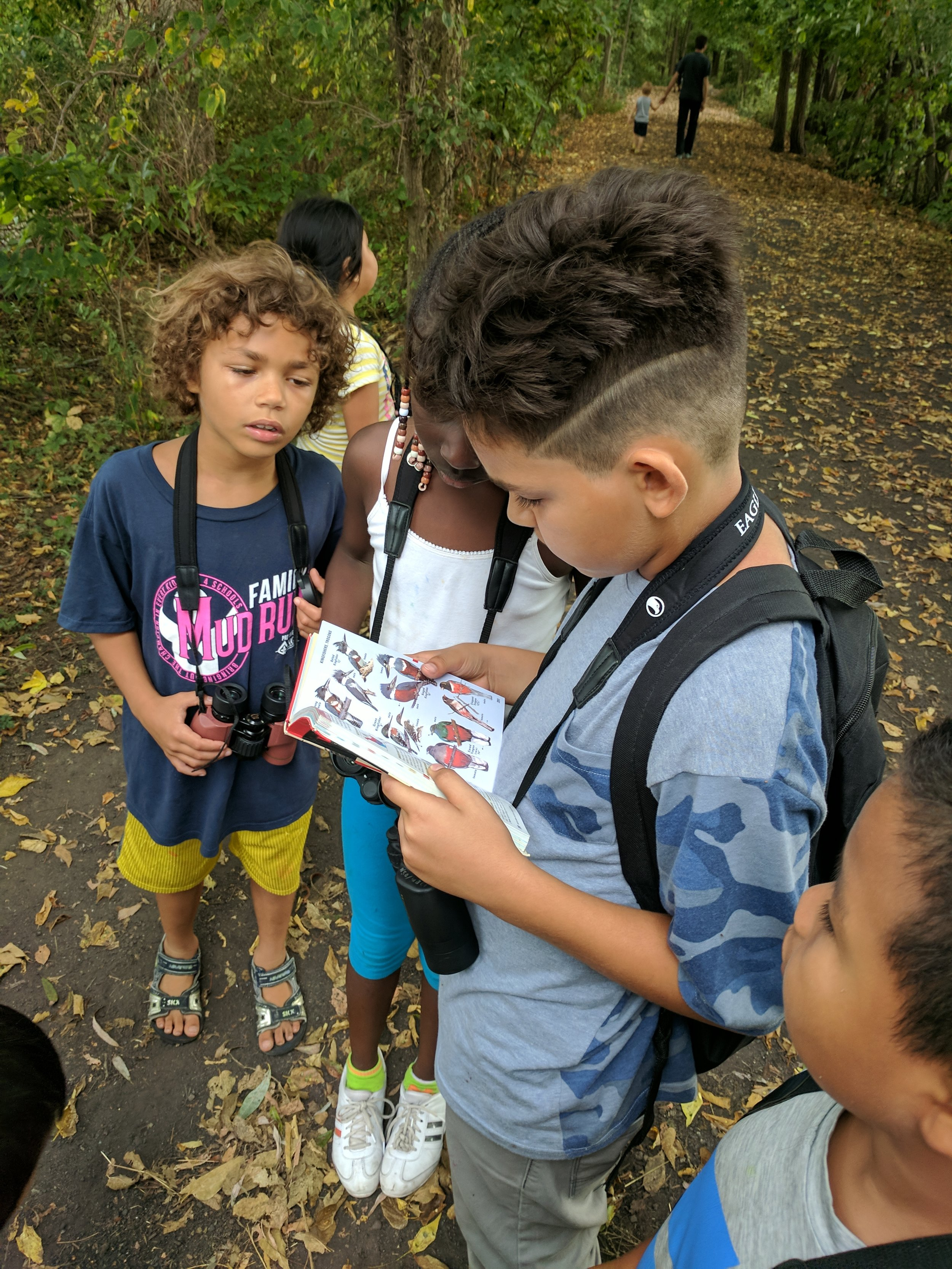 Vera kids use a field guide to identify birds seen at Governor's Island. MAS Photo