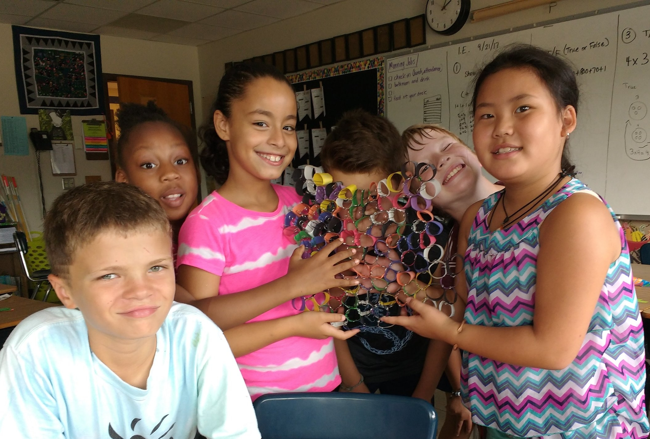 Students at Lincoln Elementary work together to build their own honeycomb. They learned a lot about hive geometry! MAS Photo