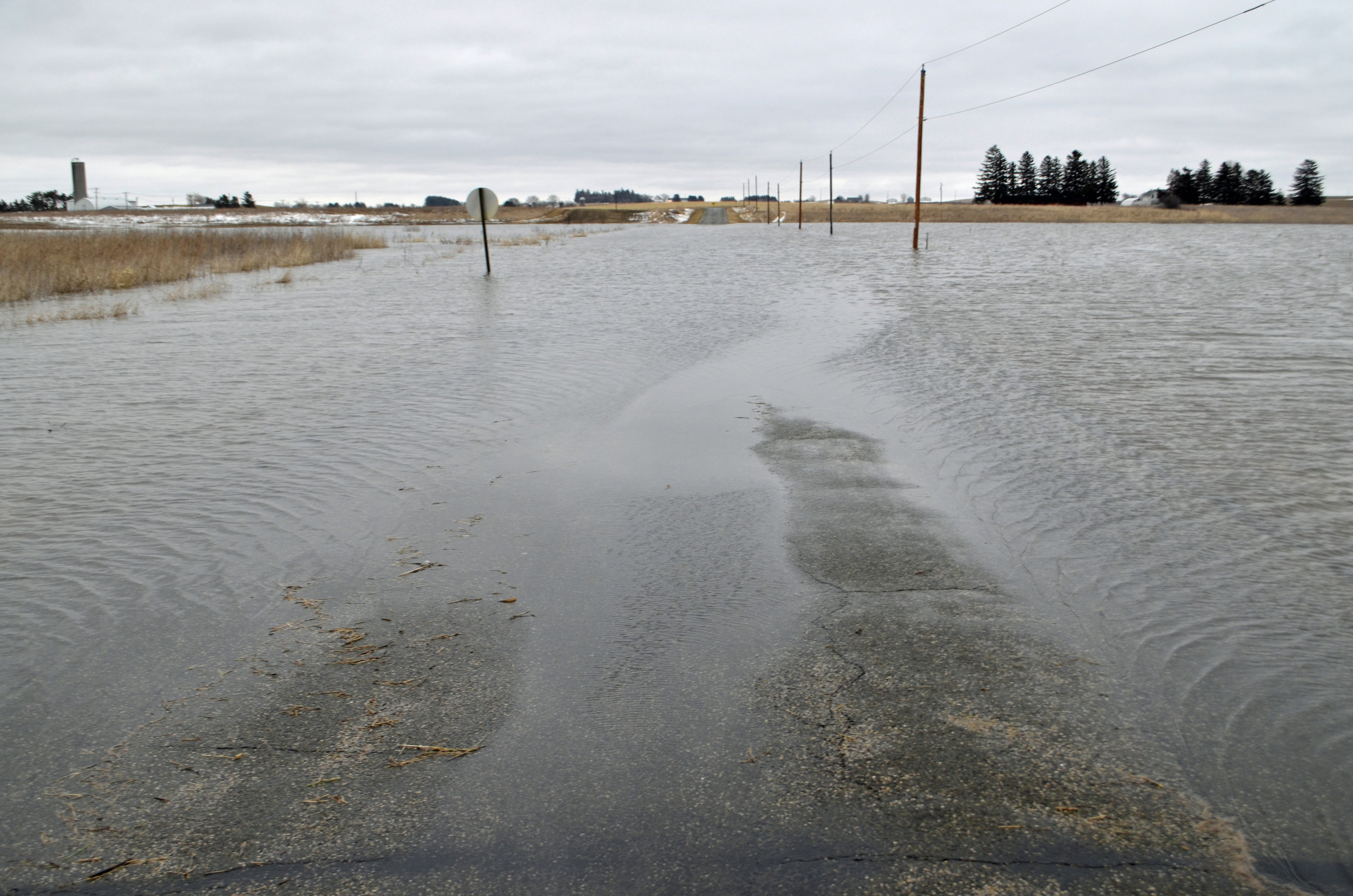 Above: Kampen Road (looking east toward Goose Pond Road).  Water is eight inches deep and covers 1,000 feet of road. So far one car stalled in the high water and had to be towed out. Some of the asphalt was deeply undercut, and there are ongoing road repairs due to safety issues.