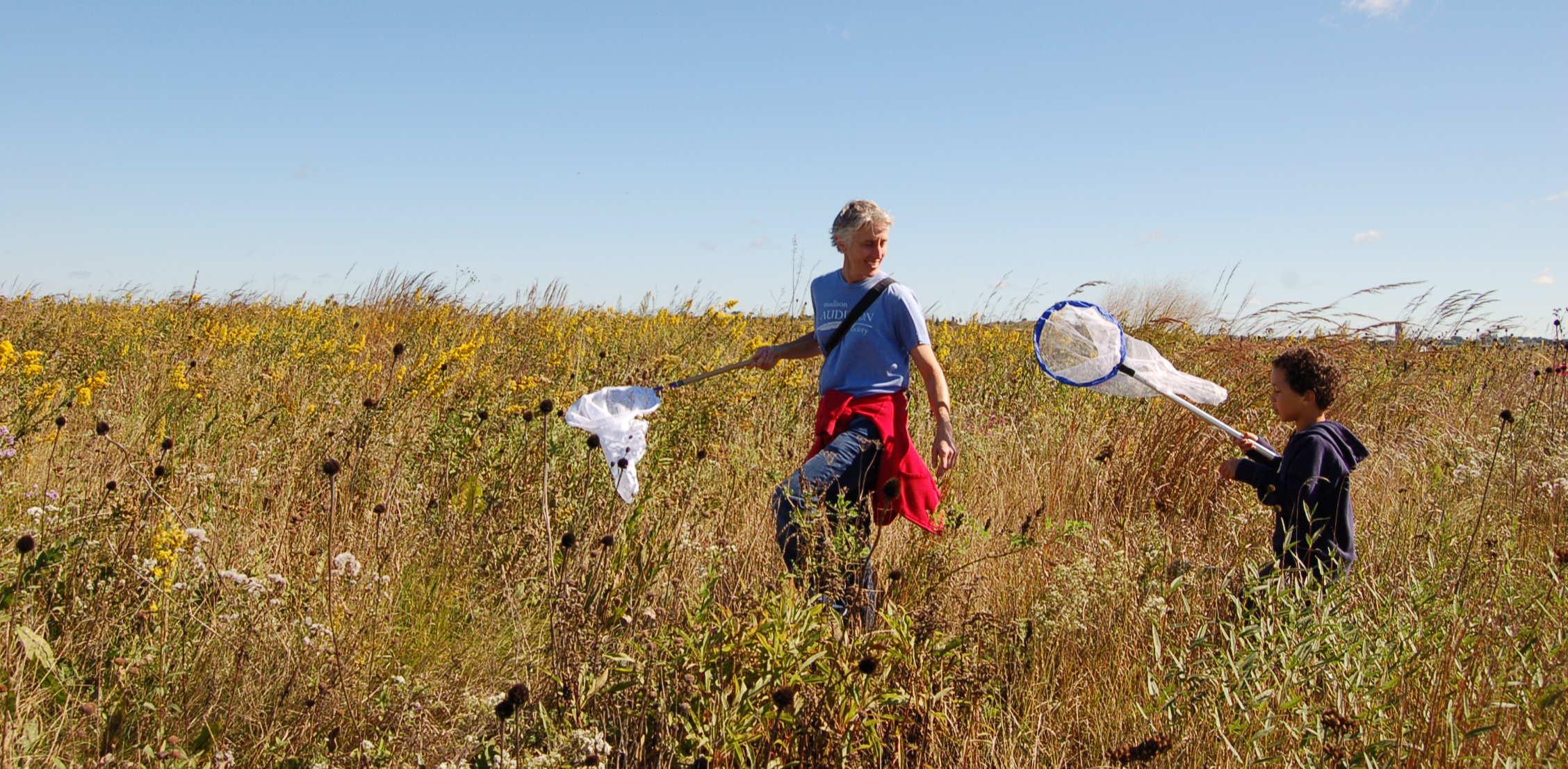 Two monarch taggers stroll through the prairie in search of butterflies. Photo by Madison Audubon