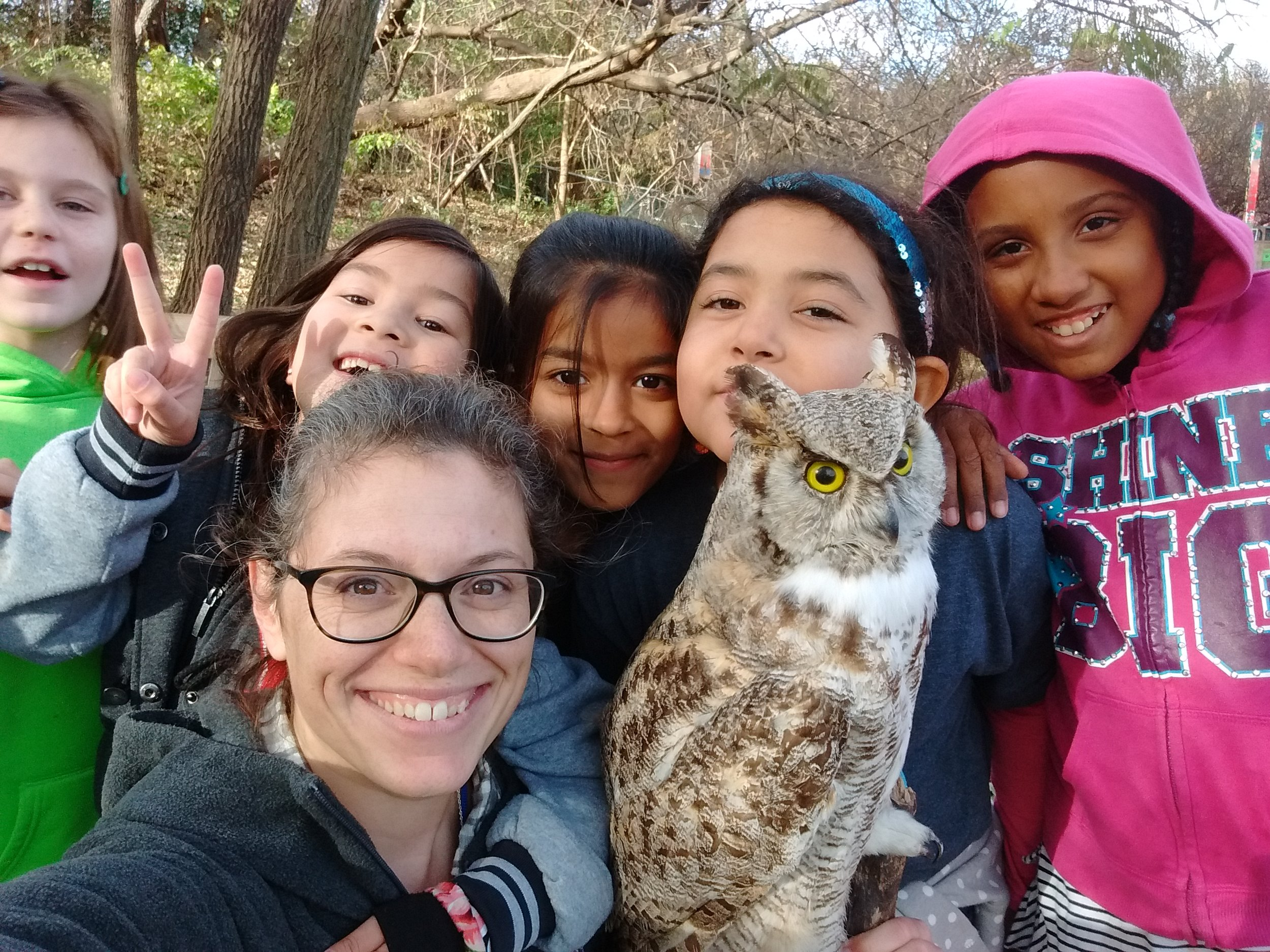 Hank, our Great Horned Owl Ambassador, gets to meet a lot of kids. Photo credit: Carolyn Byers