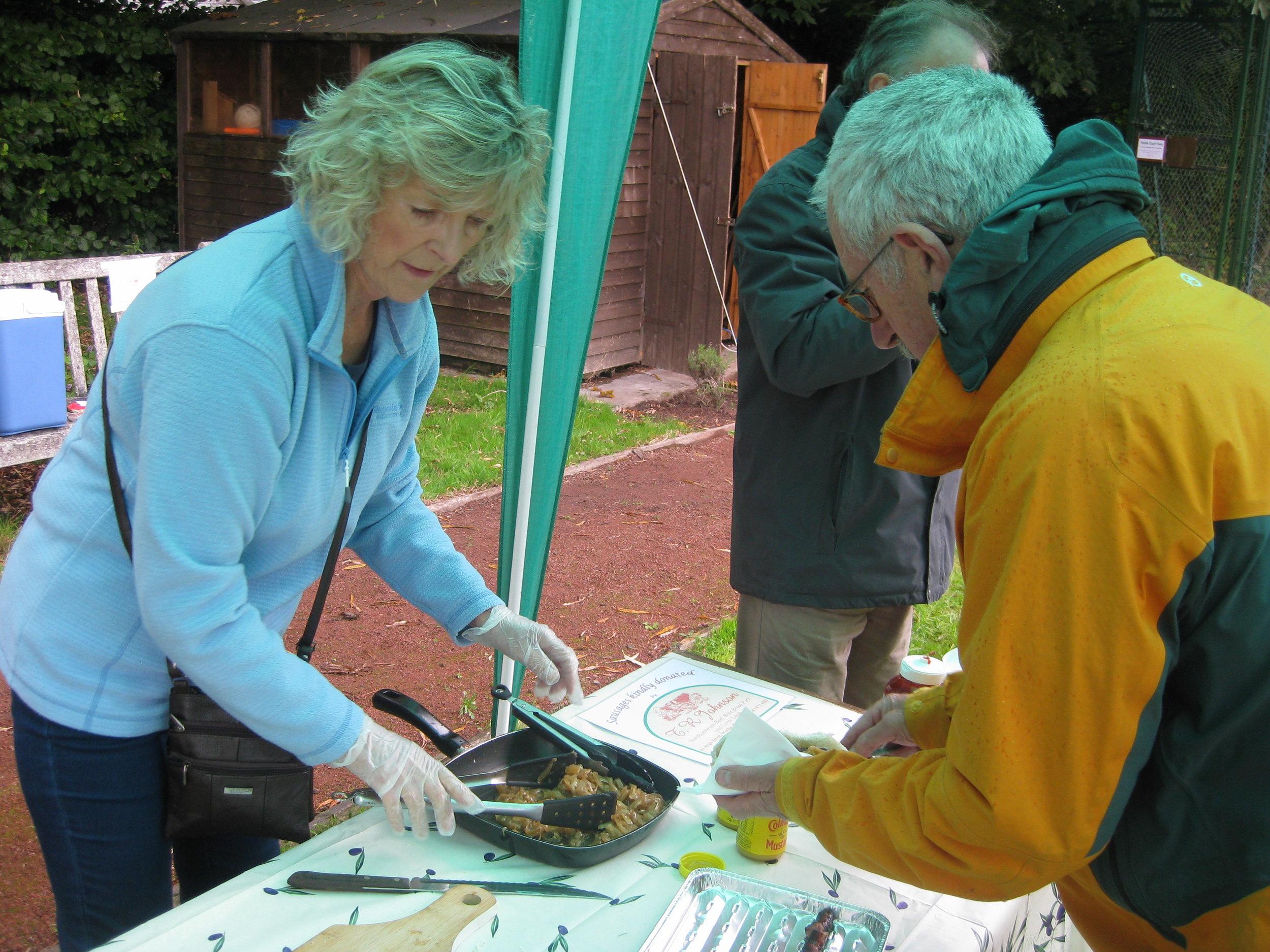 Jane serving sausage sandwiches