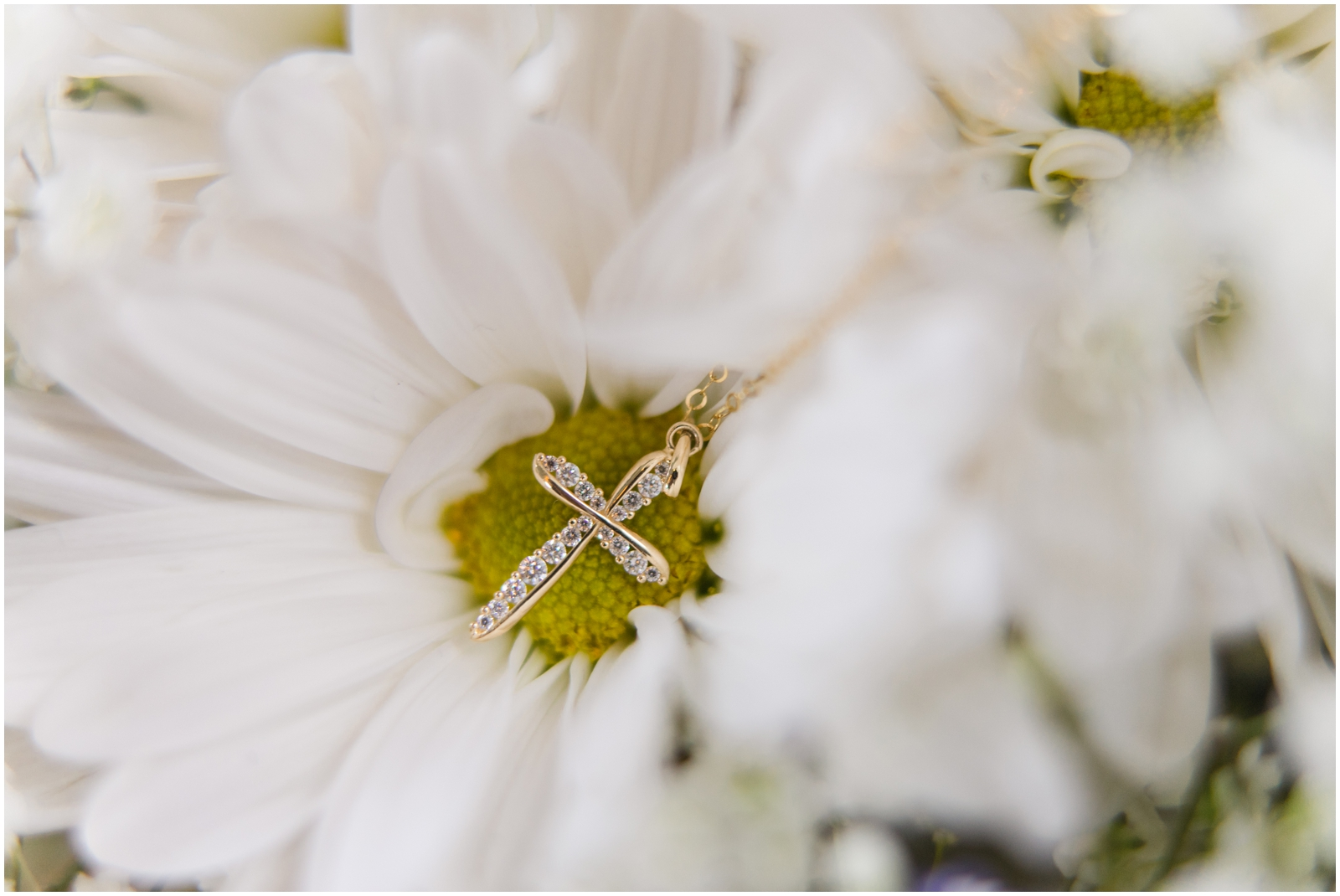 cross necklace and white flower