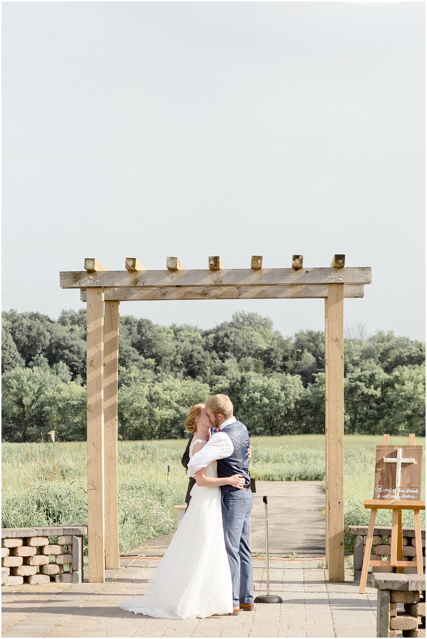 Chaska Wedding Venue MN. Bride and groom say I do and kiss