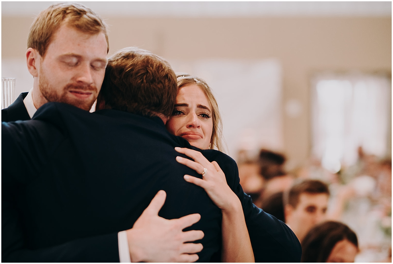 the bride and groom having an emotional hug