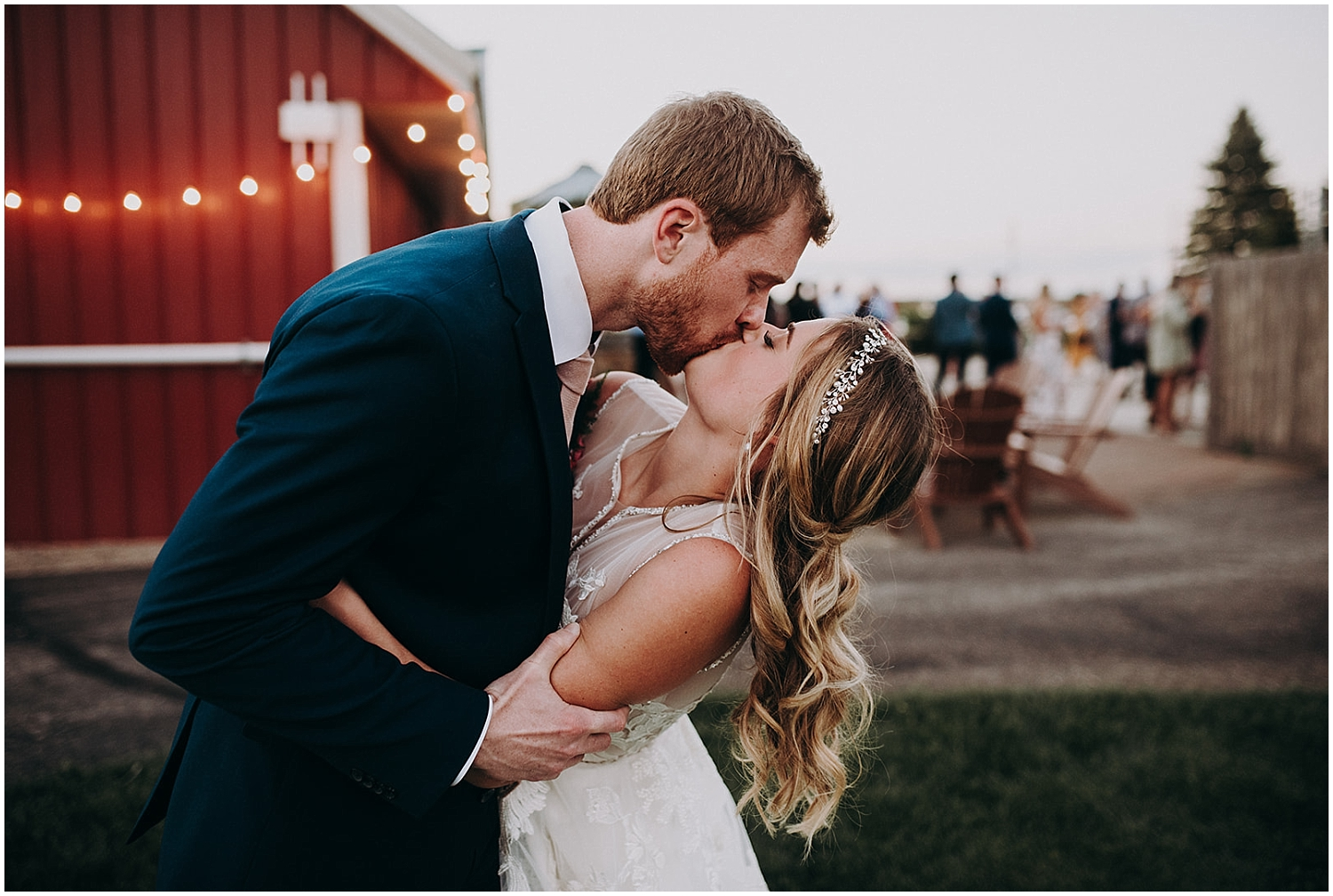 the bride and groom kiss at their MN wedding