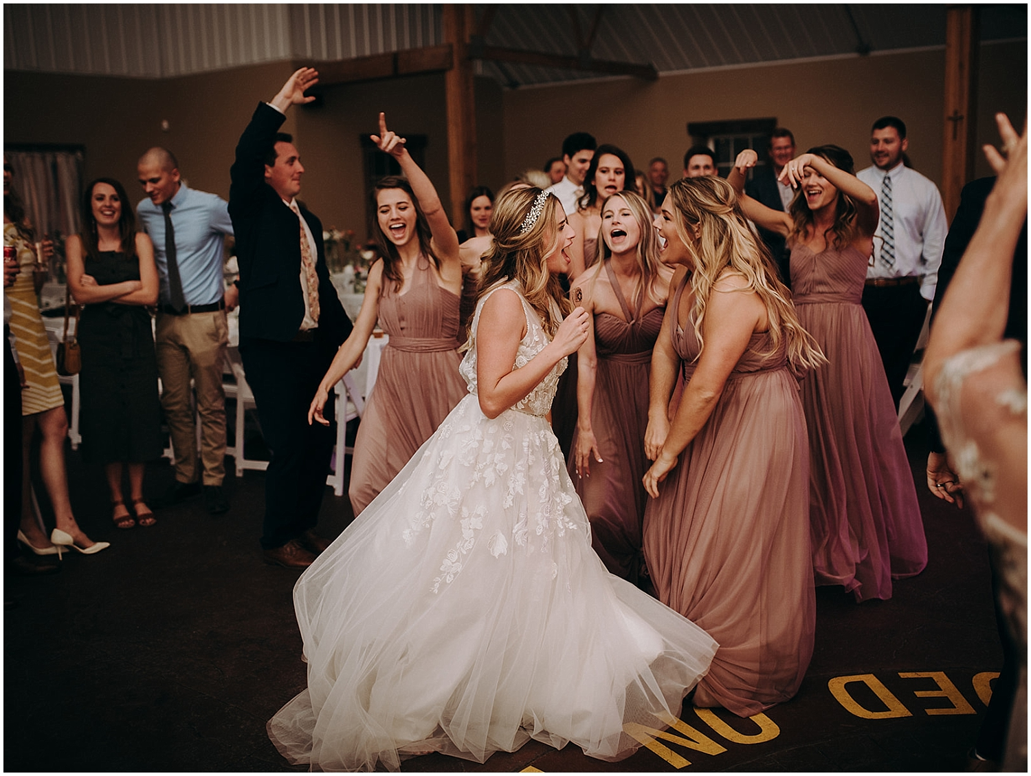 the bride and the bridesmaids dancing at the wedding reception