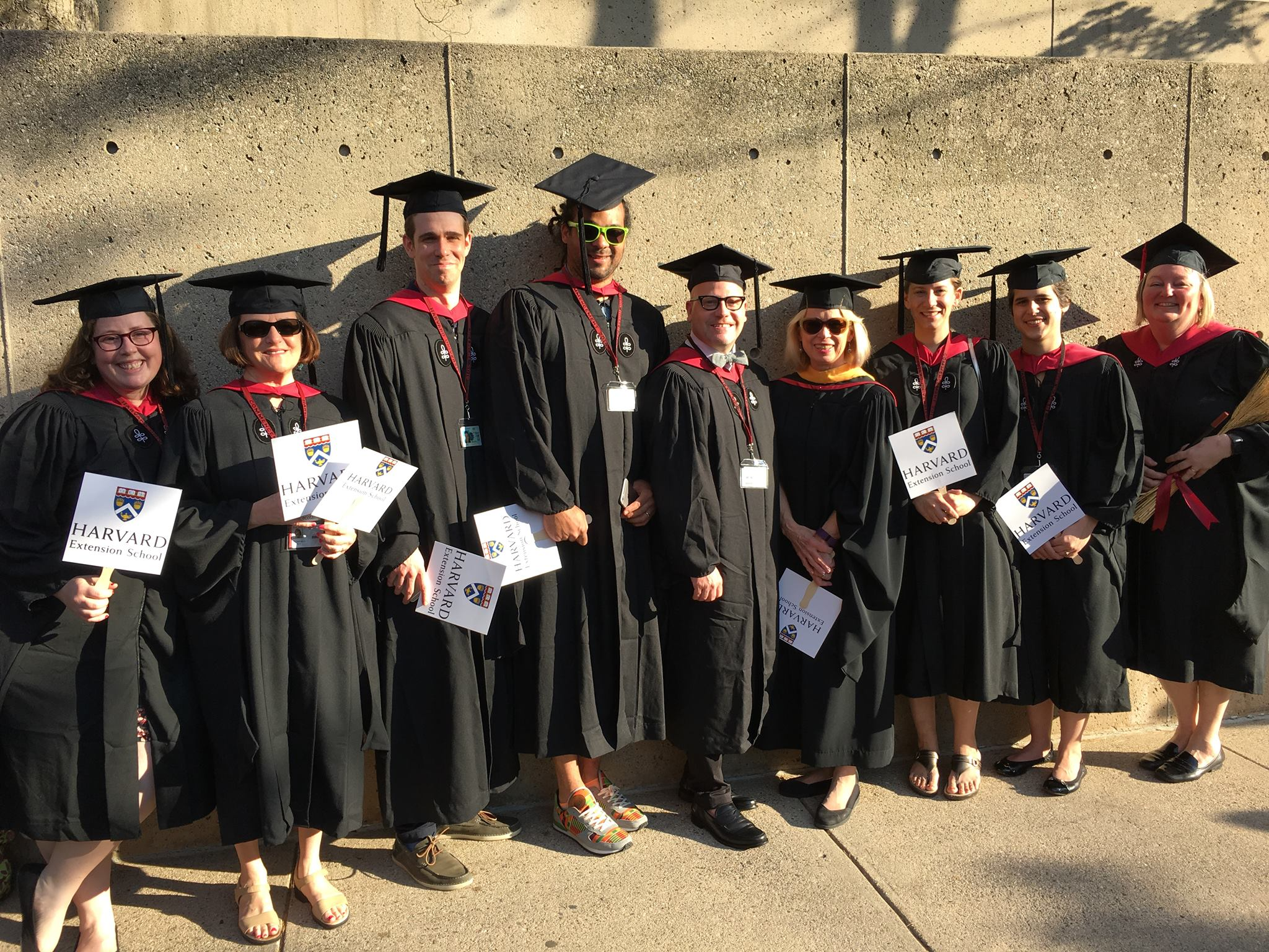 Gowns, fans, mortarboards and other tokens of achievement. 2016 Museum Studies Master's graduates with program director Kathy Jones. Photo by Kathy Jones.