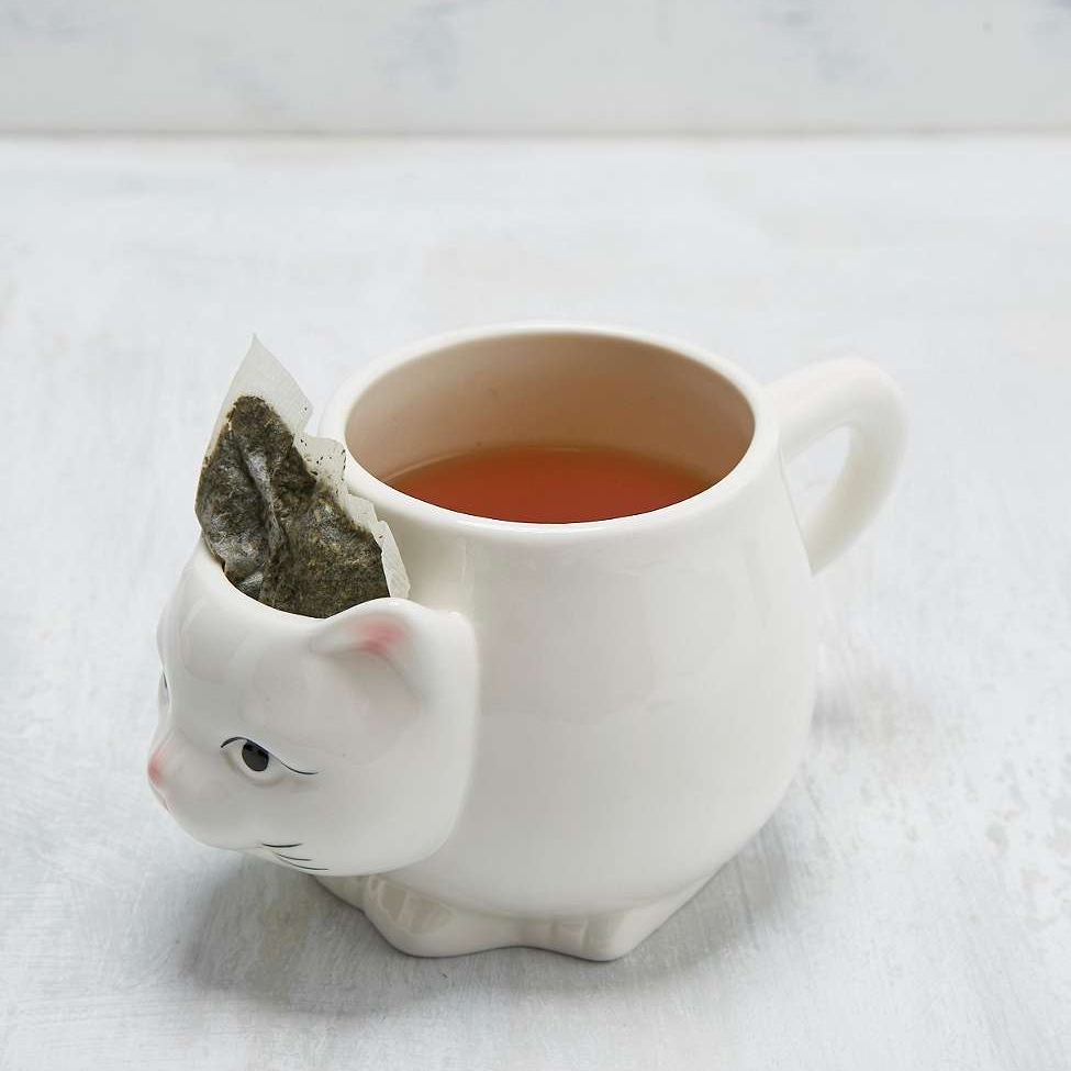 I have no problem with the cat, but the teabag in the head of the cat? Why? Just get rid of the tea bag in accordance with normal tea-making protocol. Why are you saving it? Won't it just flop out or brush your face when you take a sip? Why do people save tea bags like they're cherished photographs?