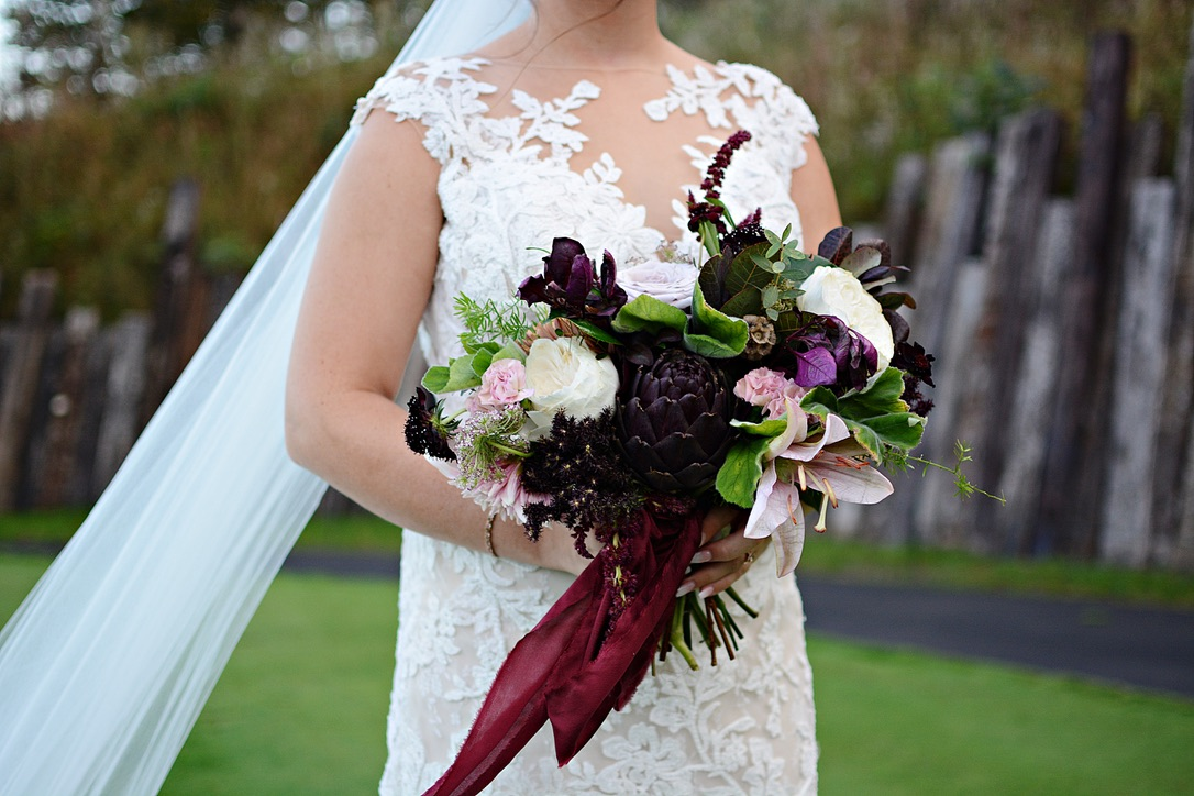 An Elegant Dark & Moody Toned Wedding | Black, Oxblood, Burgundy, Purple Theme with Artichoke, Winter, Fall, Outdoor Wedding | Florals by Loveshyla.com