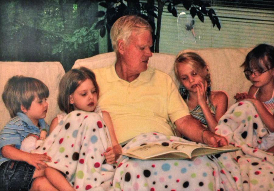 GrandDad reading to his grandkids in Katie's hospital room