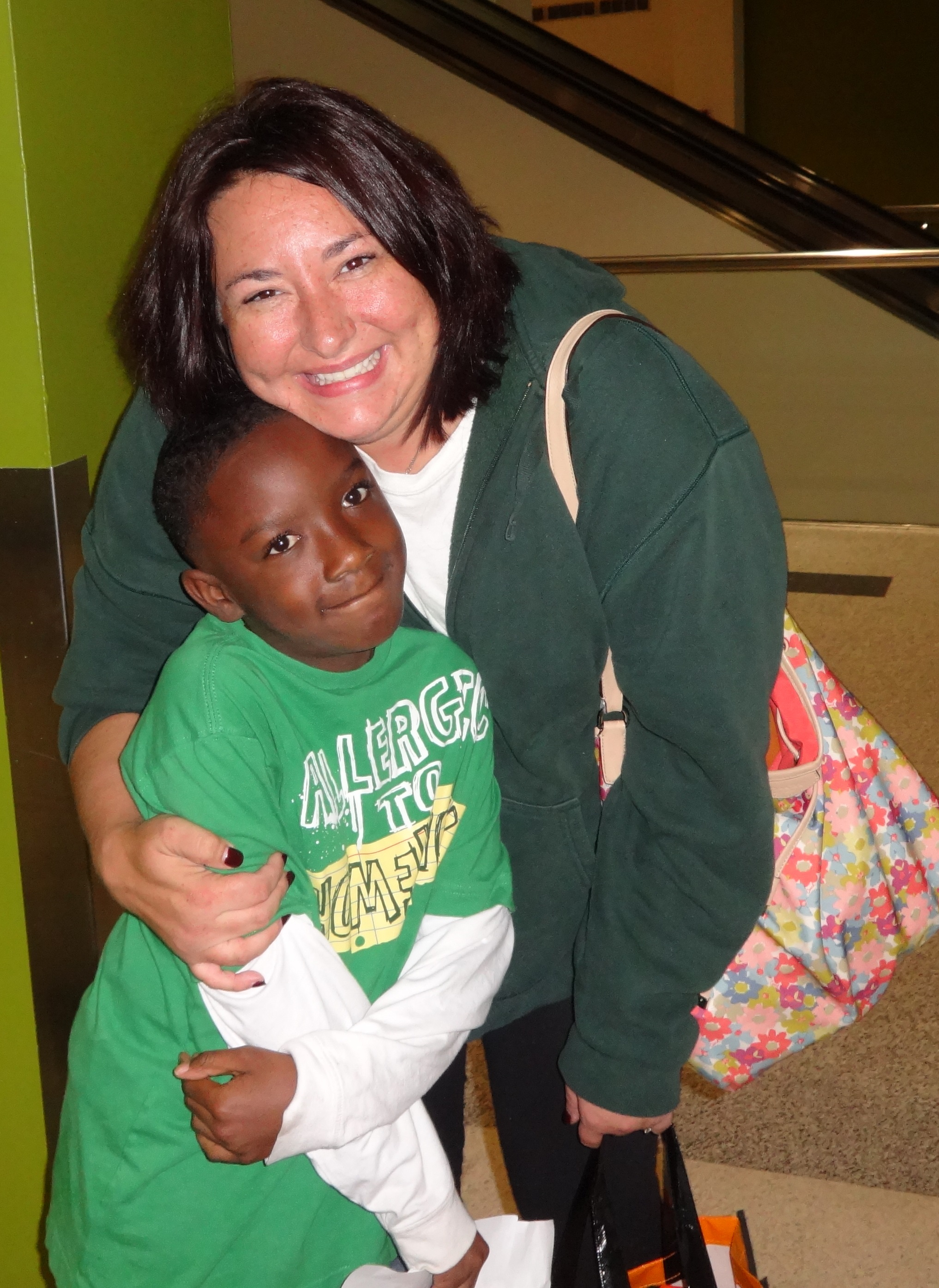 Melanie welcoming home a client's son at the airport.