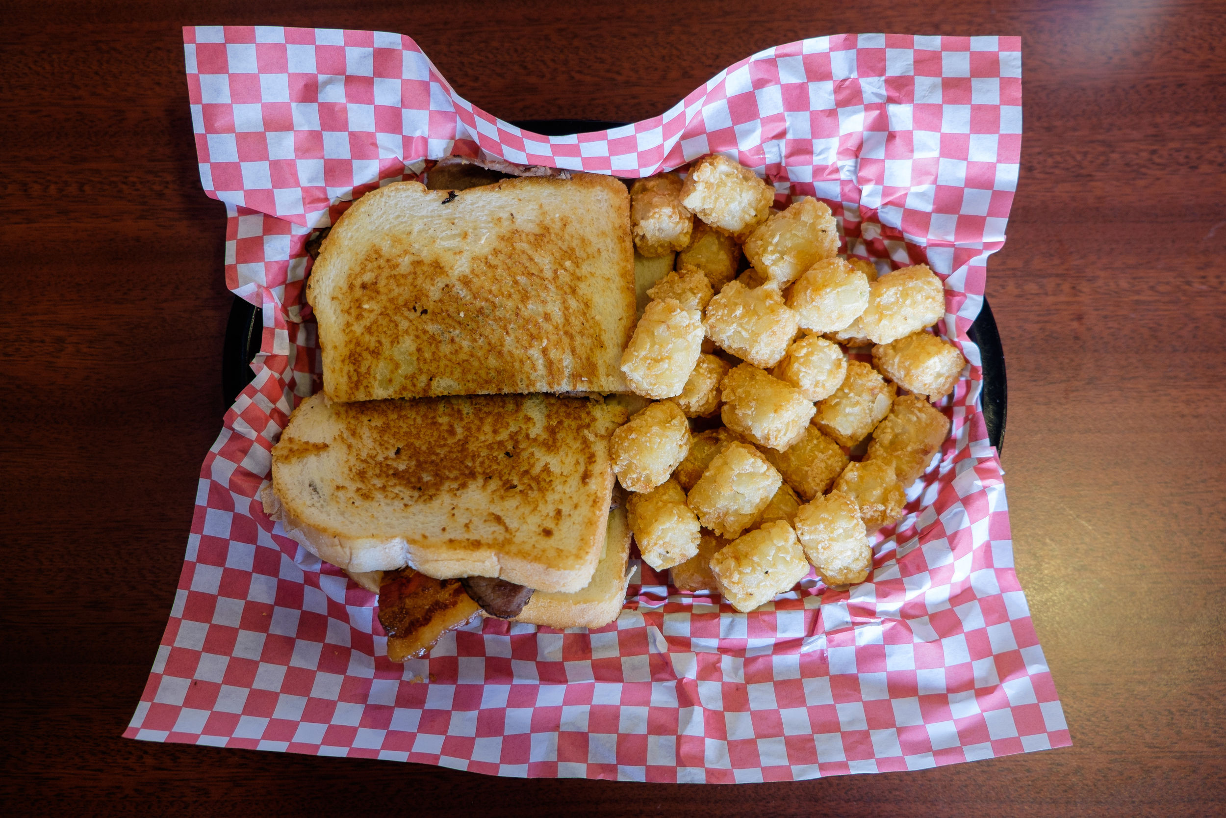 Grilled cheese with bacon and a side of tots. Classic.