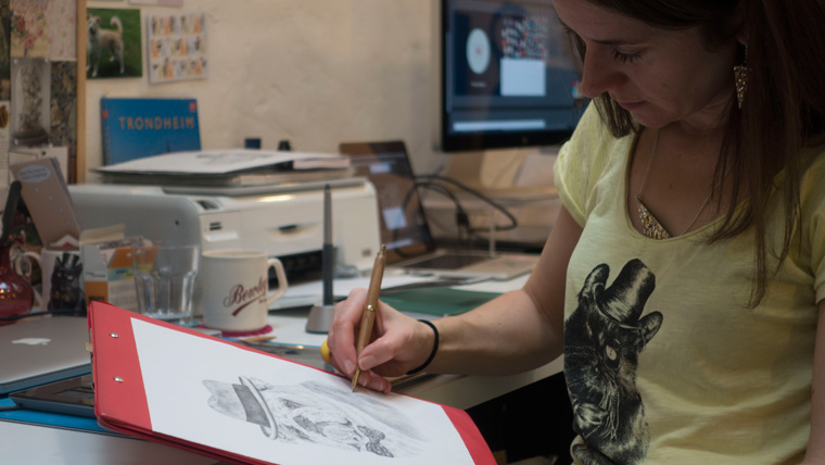 Katrina Wight from The Kat and Monocle working on a drawing