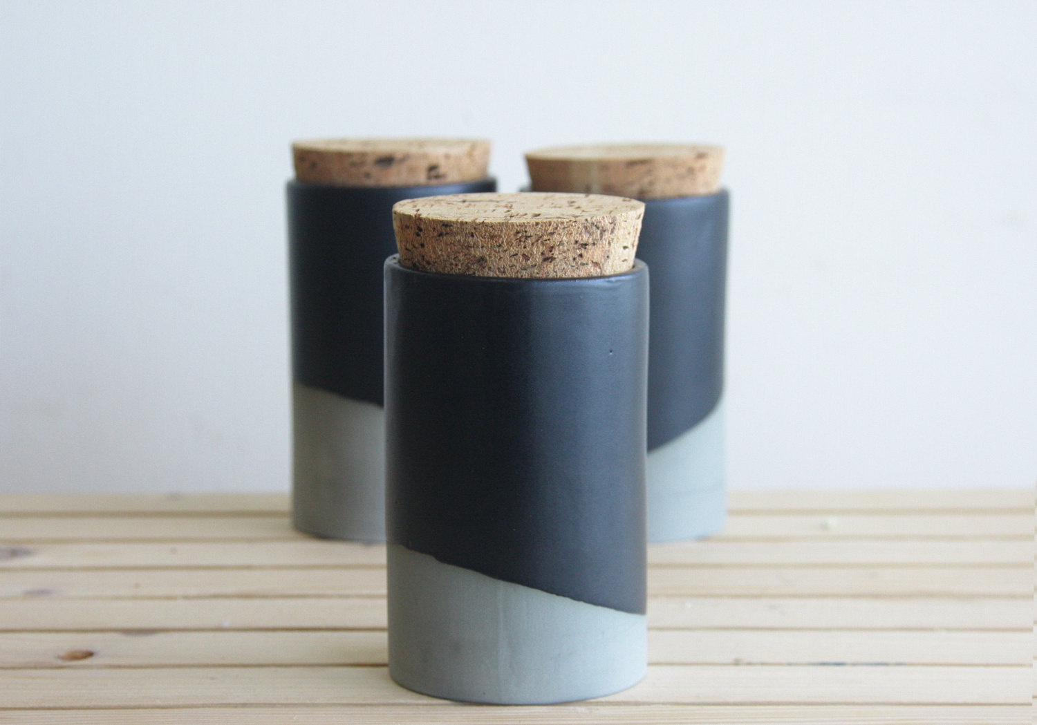 Ceramic jar with cork lid in grey with black matte glaze by ONEandMANY