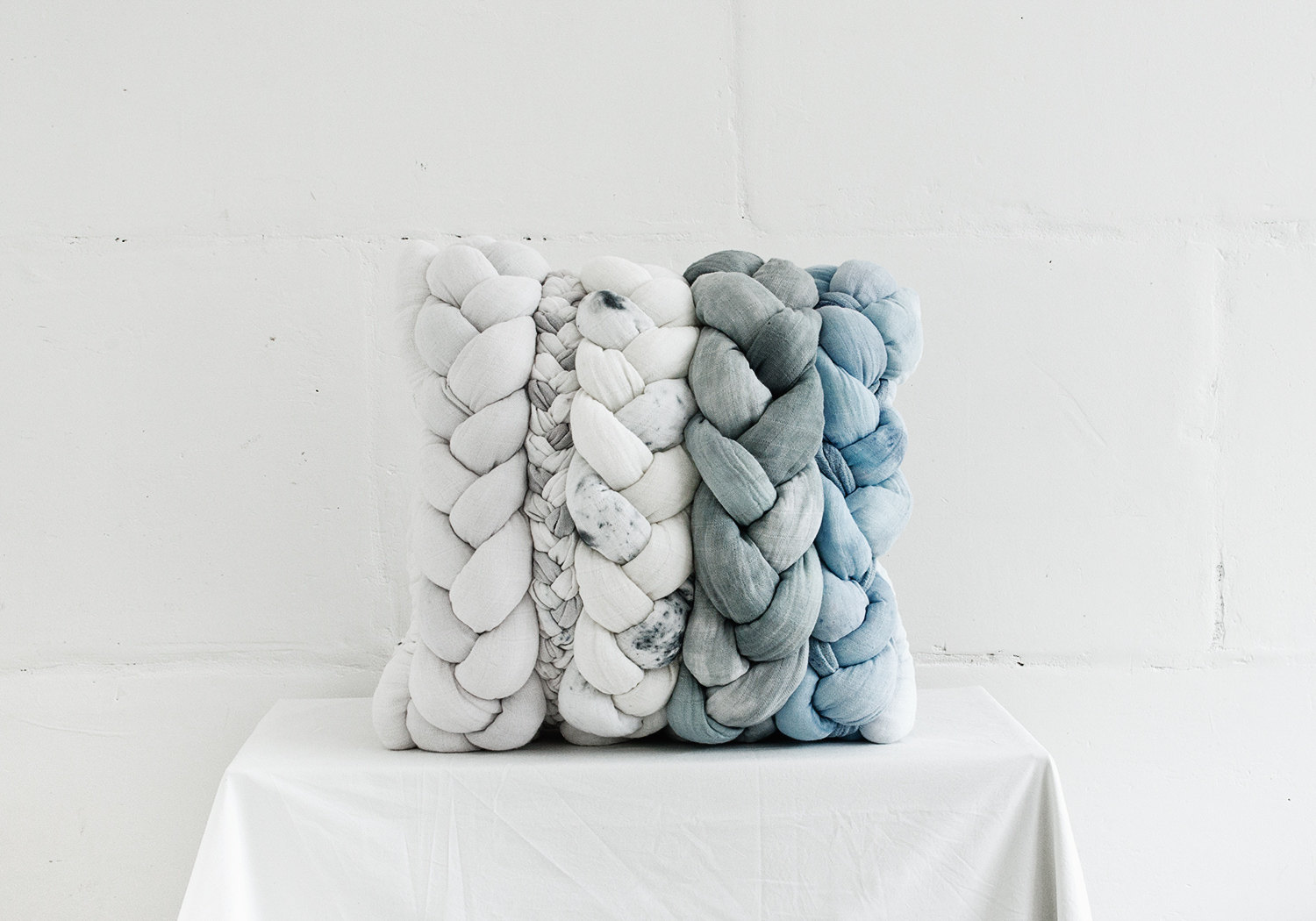 Grey and blue hand-dyed braided cushion by Taftyli