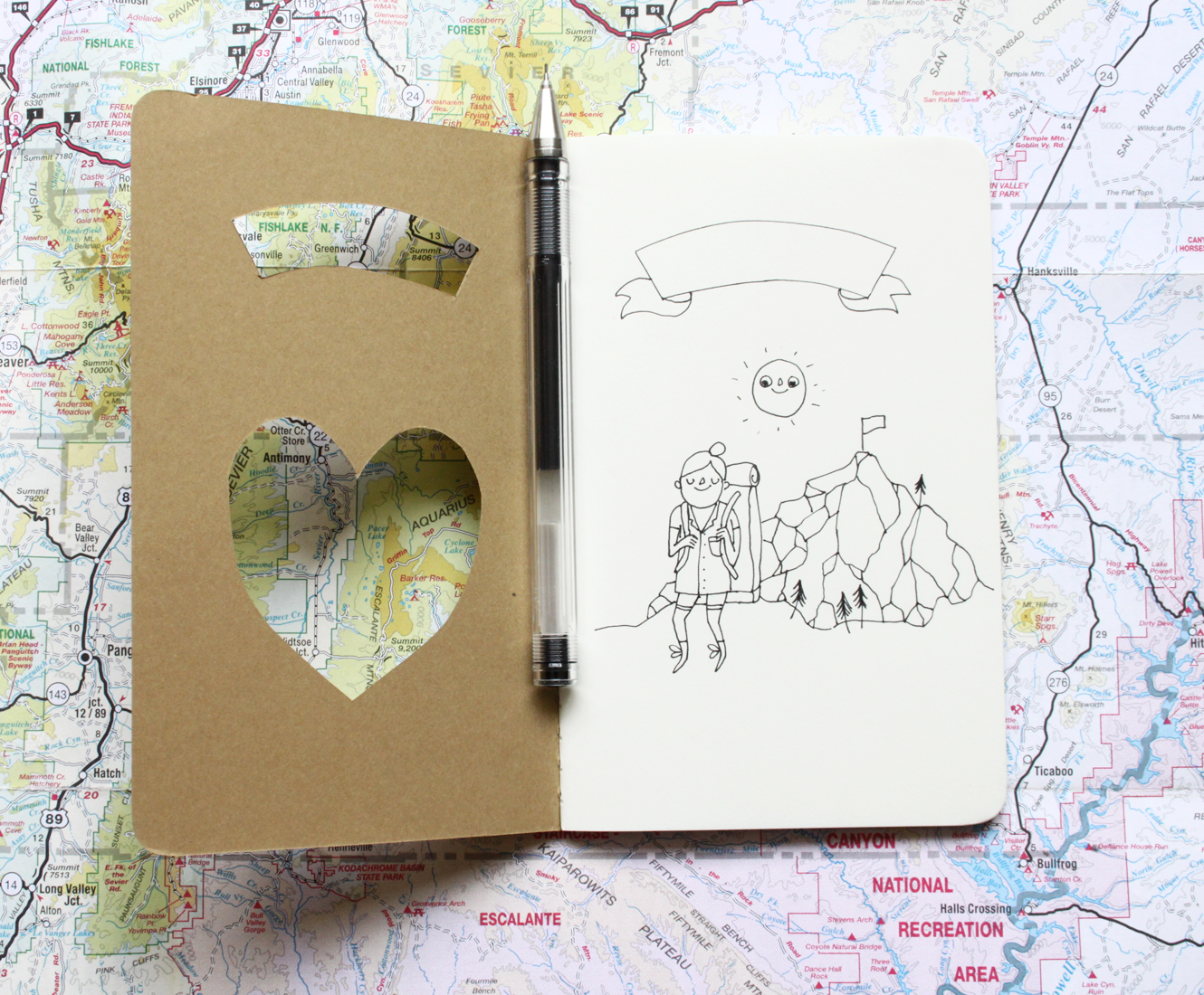 Hiker journal with cut-out heart and hiker/backpacker illustration.