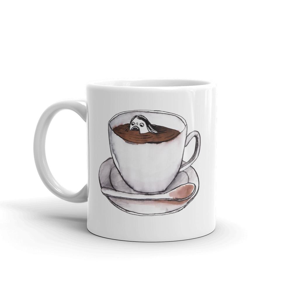 Swimming in tea cup mug