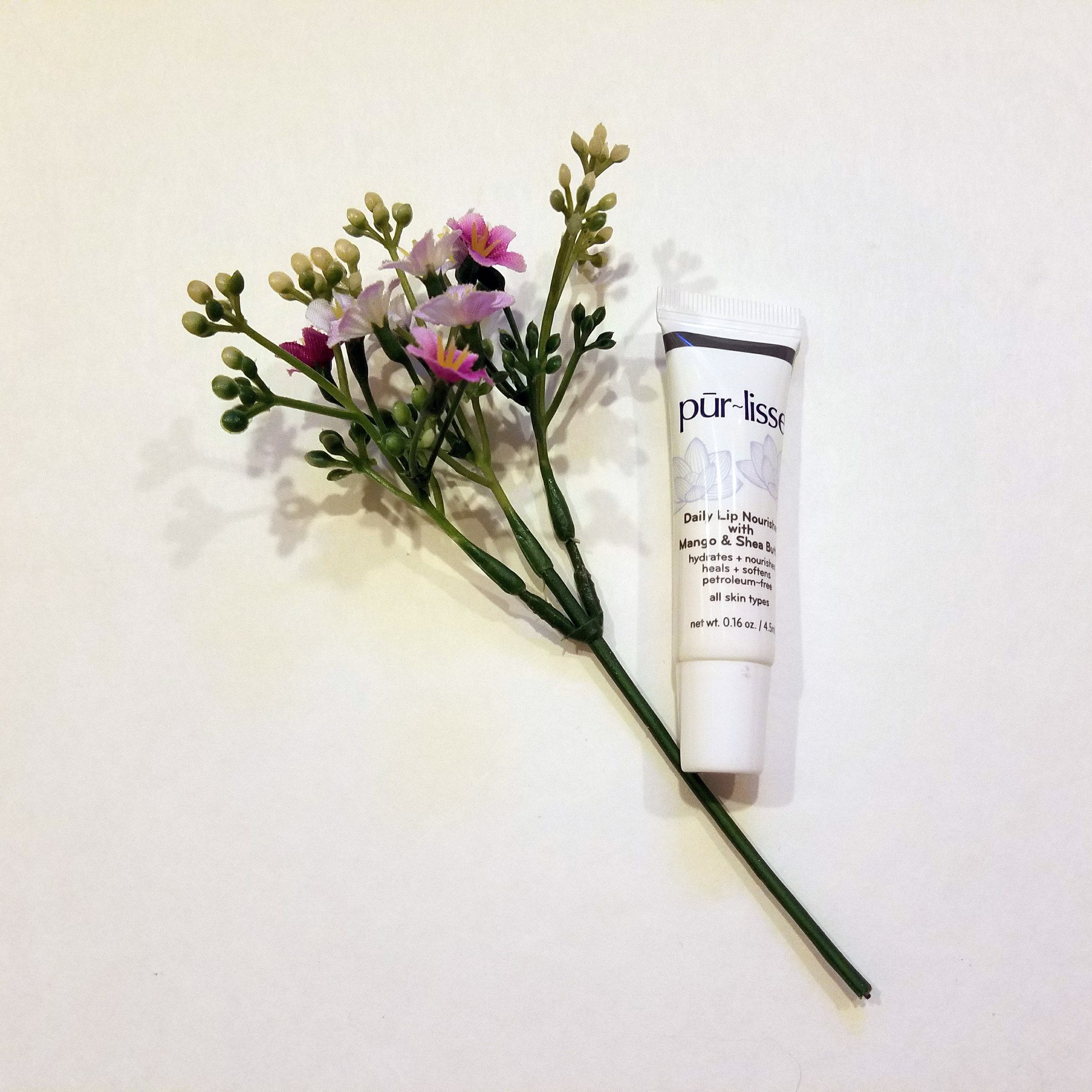 pur-lisse daily lip nourisher with mango and shea butter