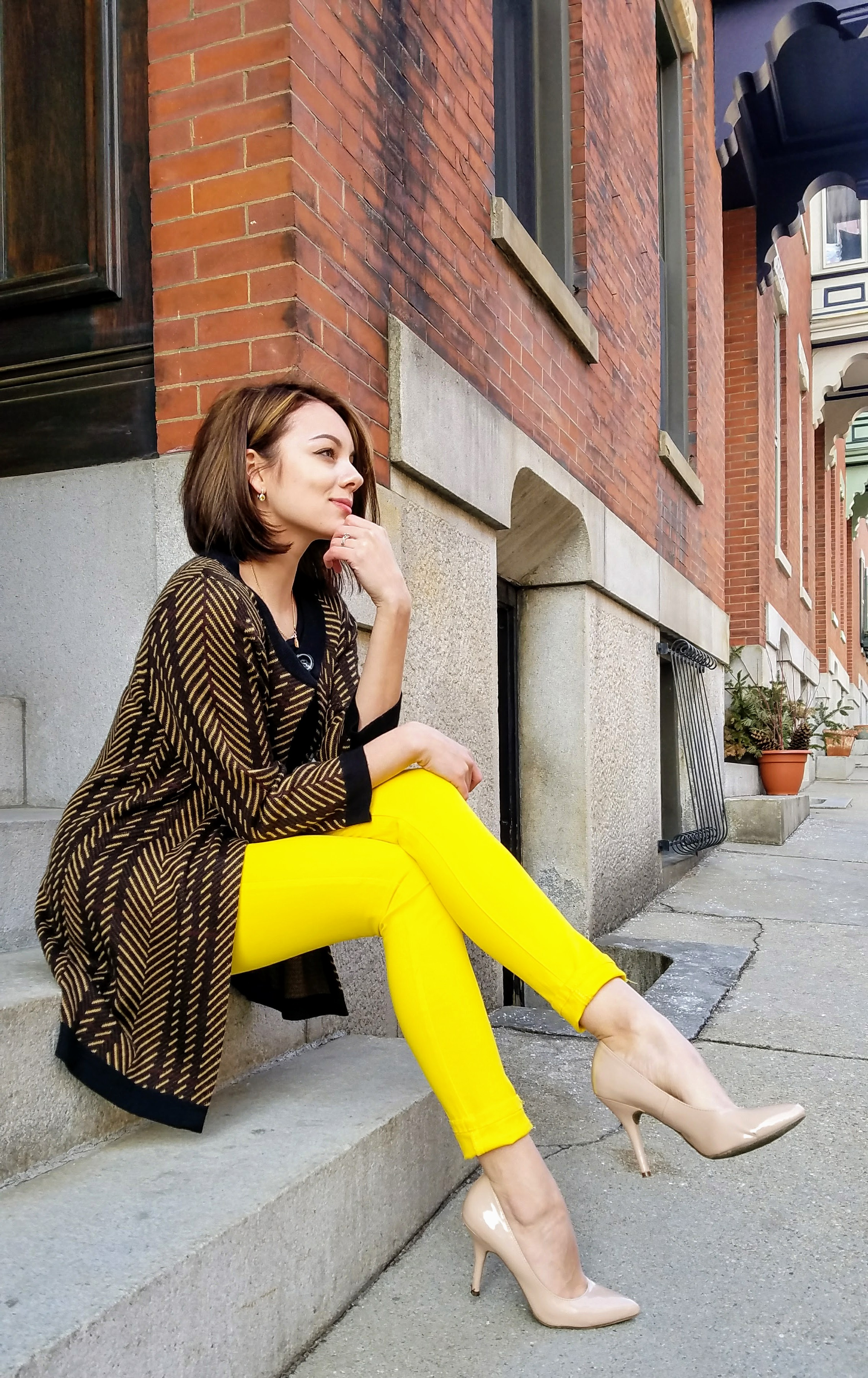 A girl wearing yellow jeans for her blog