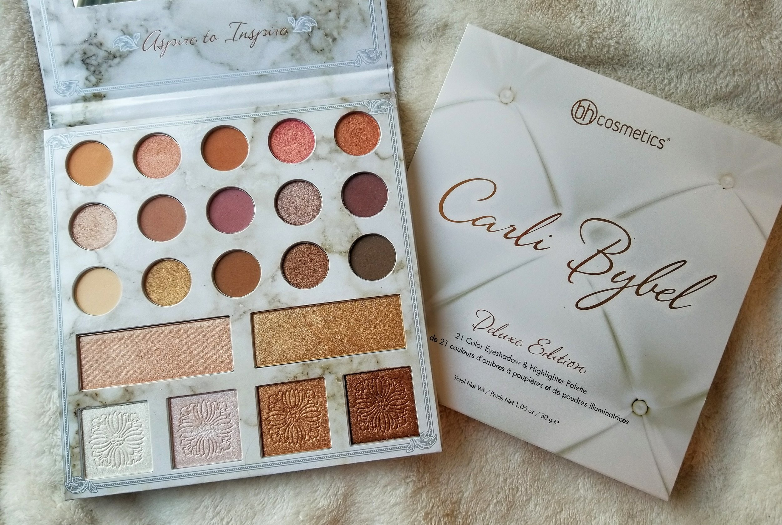 A photo of Carli Bybel deluxe edition eyeshadow and highlighter palette.