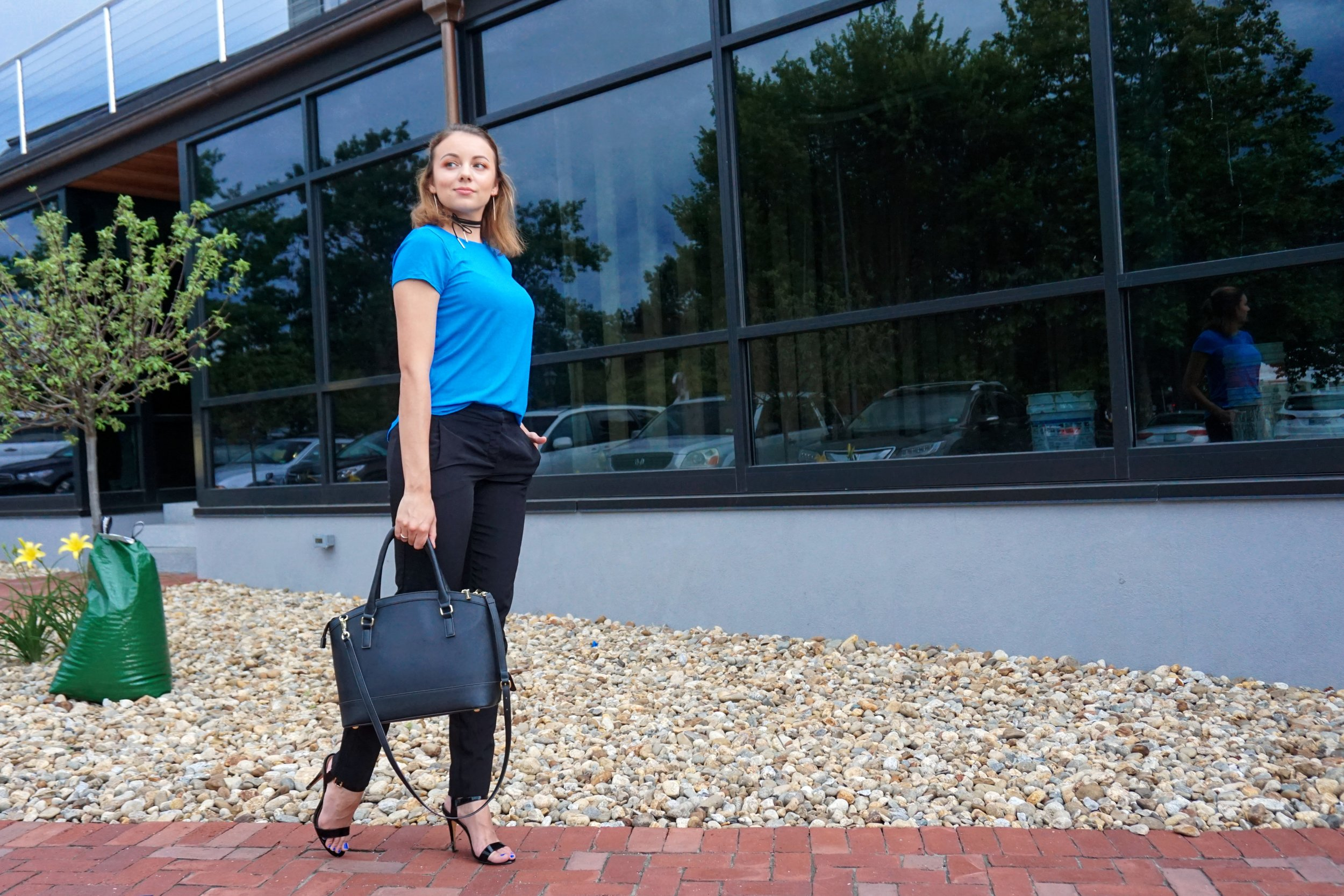 Outfit details: black pants, high heeled sandals, black purse, simple blue top, and a black choker.