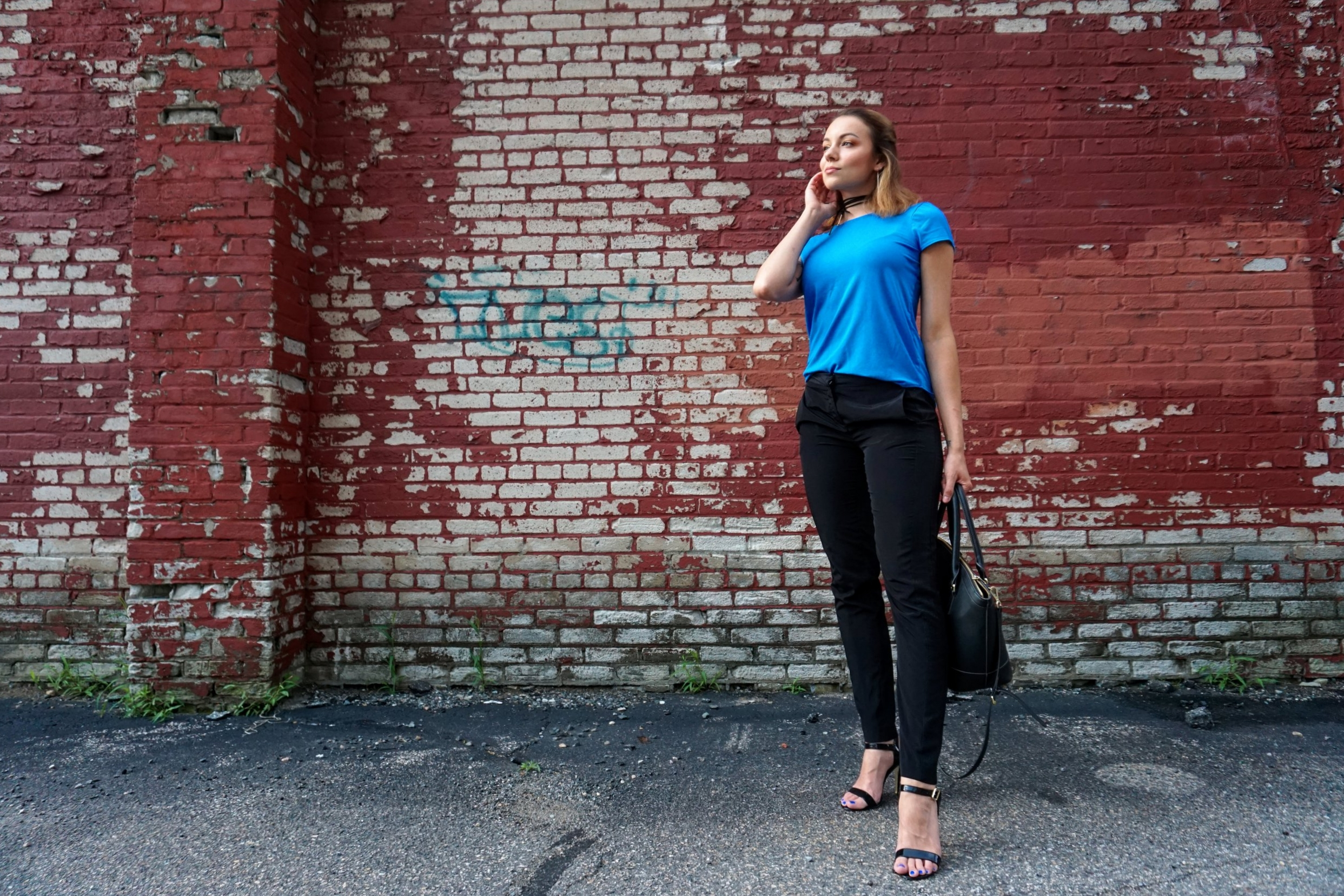 Casual outfit of the day: blue casual top, black straight pants, black high heeled sandals, black bag, and a black choker.