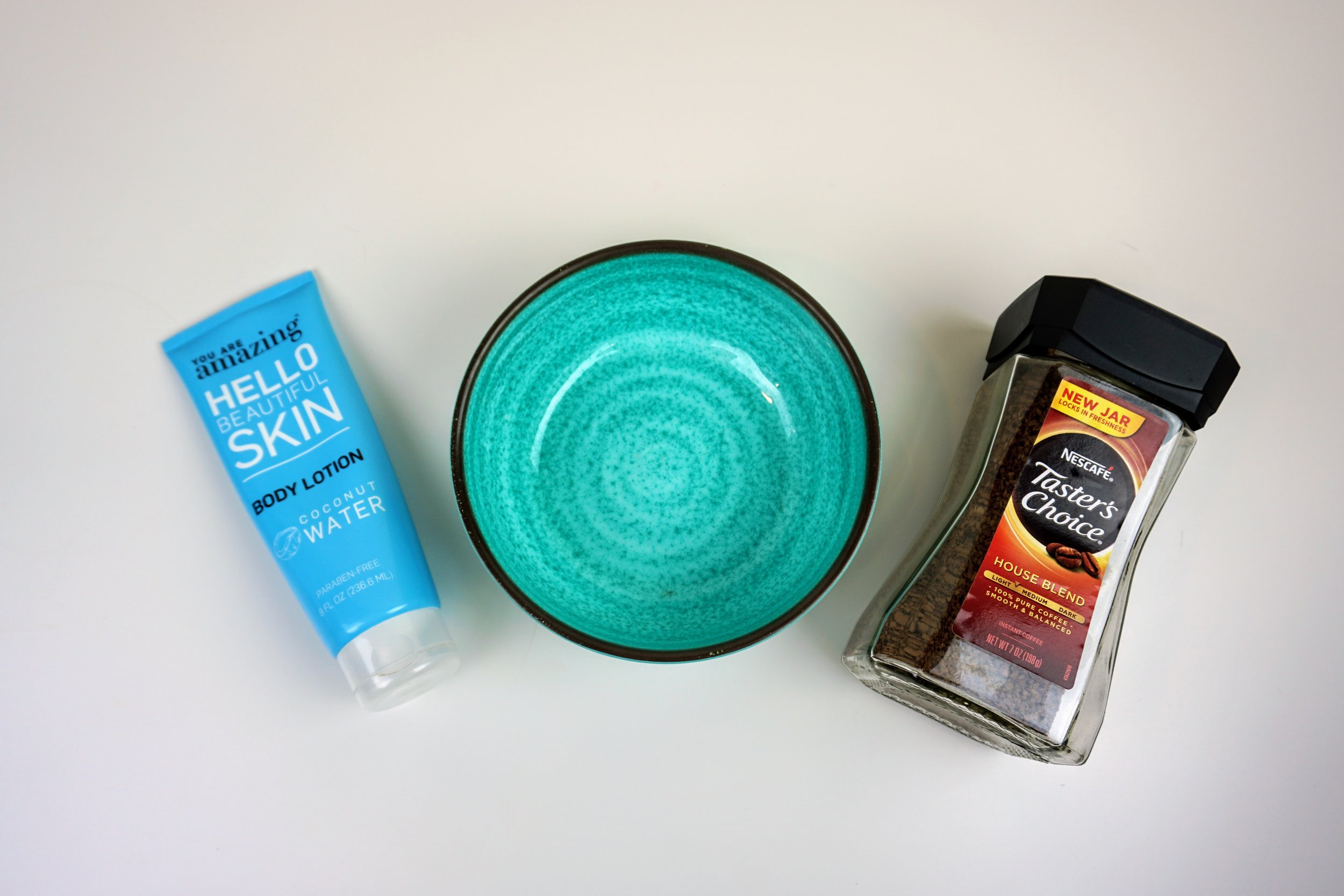 A photo of a bowl, coffee, and a lotion. This is a mix that will create a self-tanner.