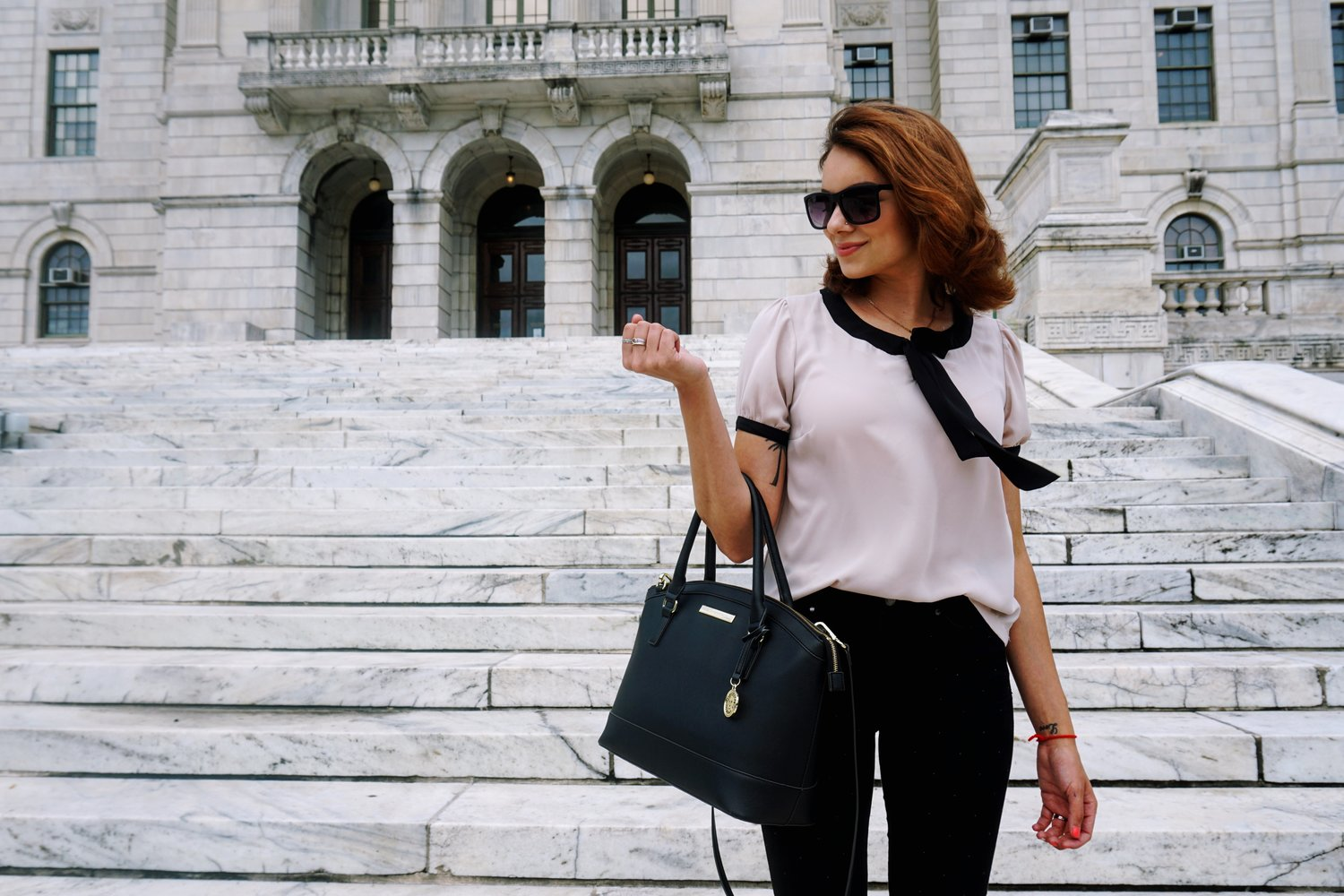 Big black purse with a business casual outfit.