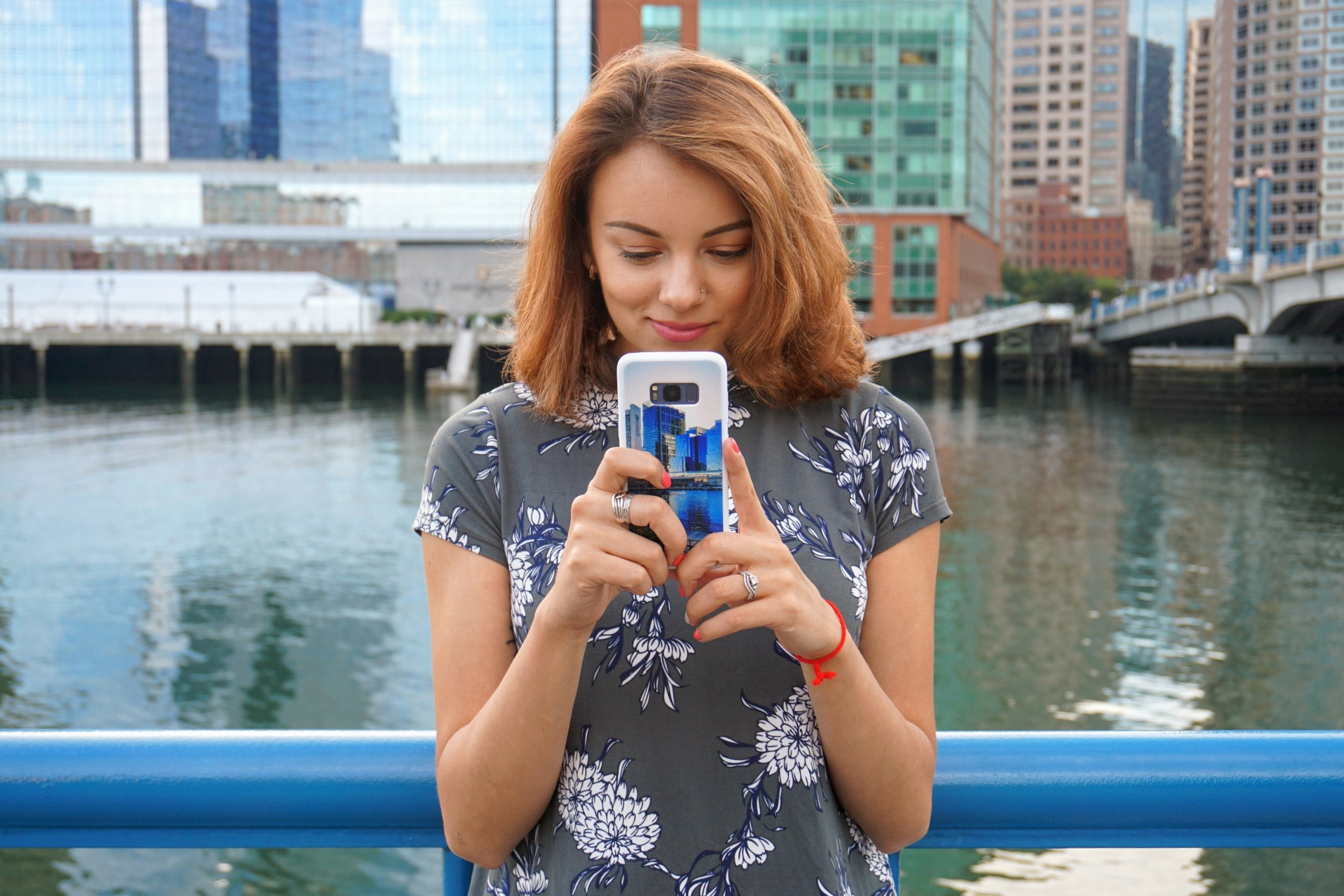 A blogger taking a photo with a samsung s8.