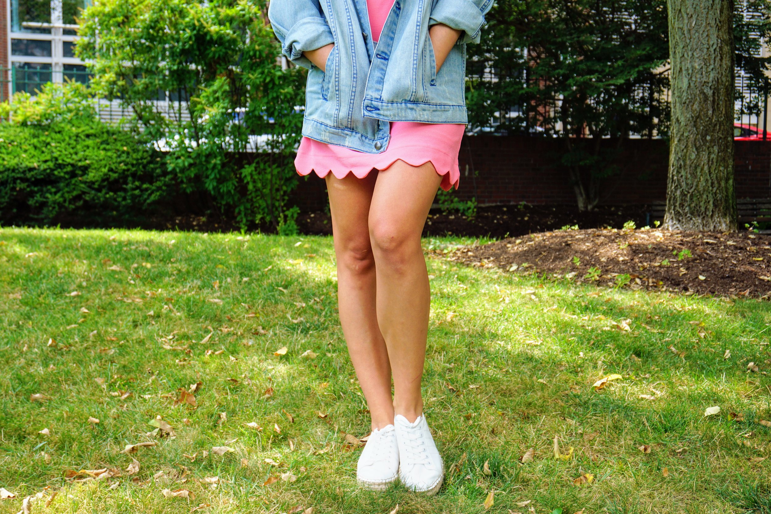 Outfit details: pink dress, oversized denim jacket, and white sneakers.