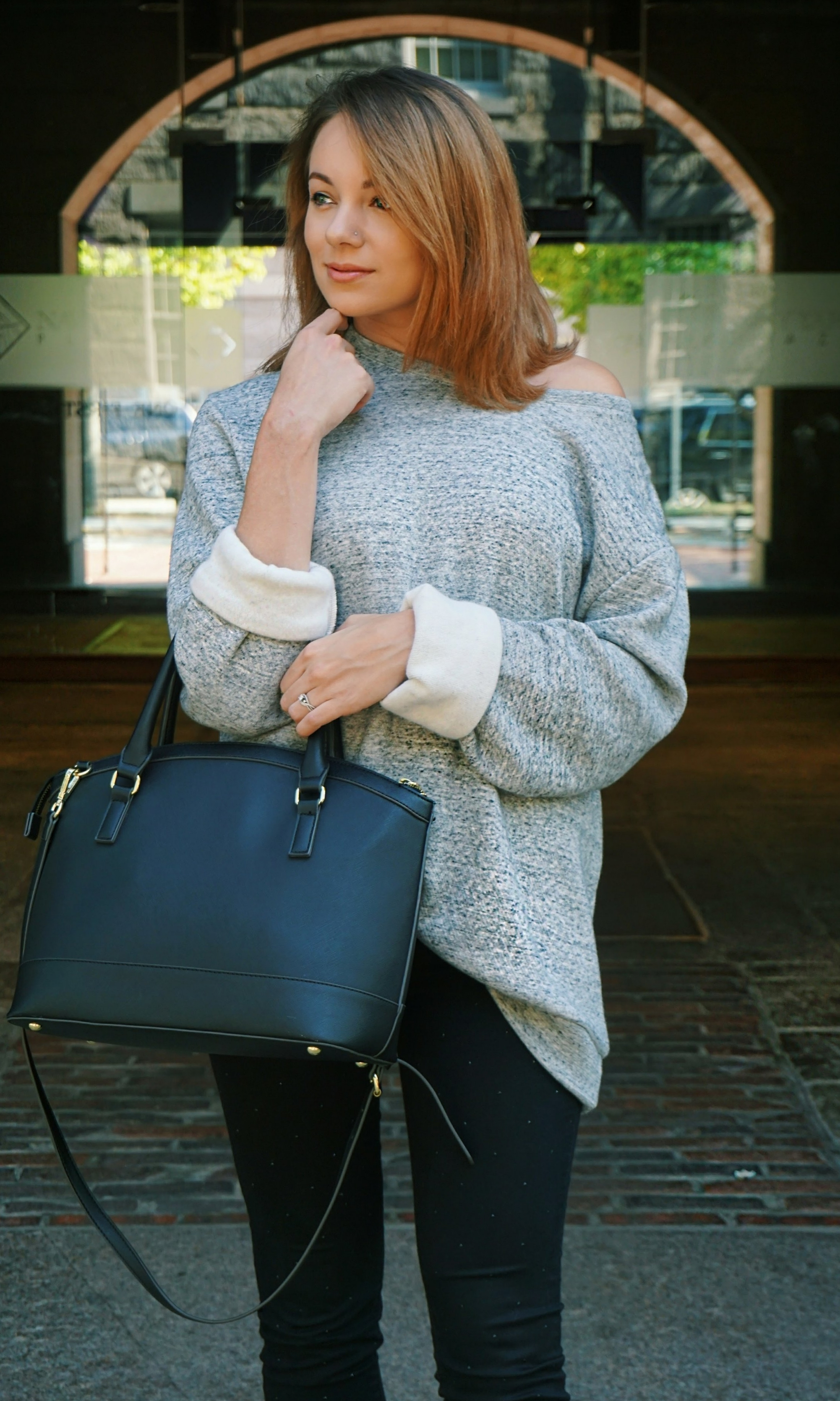 Beauty blogger wearing a men's oversized sweater, off-the shoulder oversized sweater.