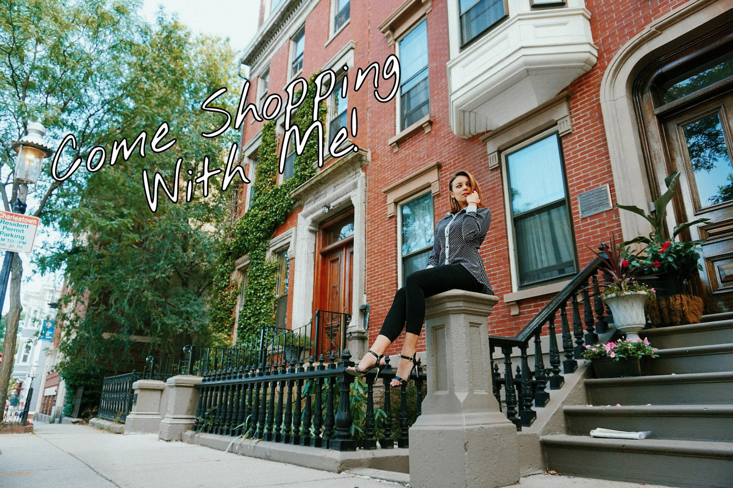 A blogger sitting near the brick house.