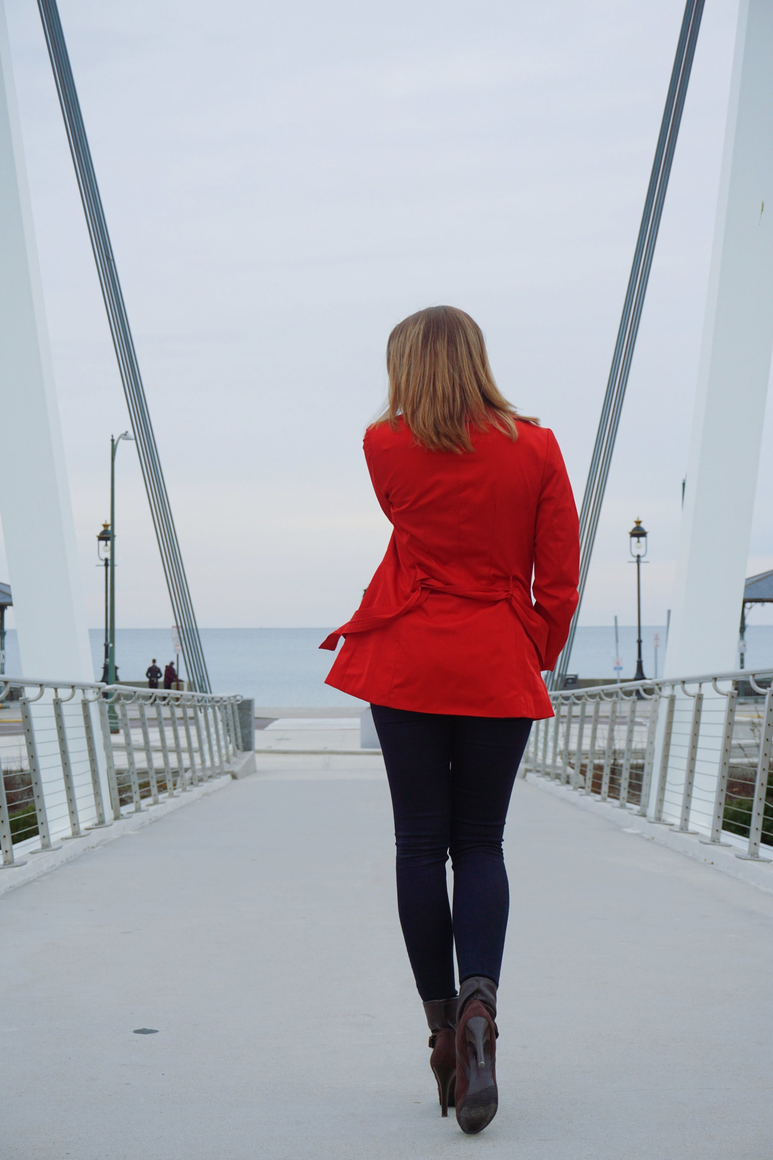 The back details of blogger's red coat outfit.