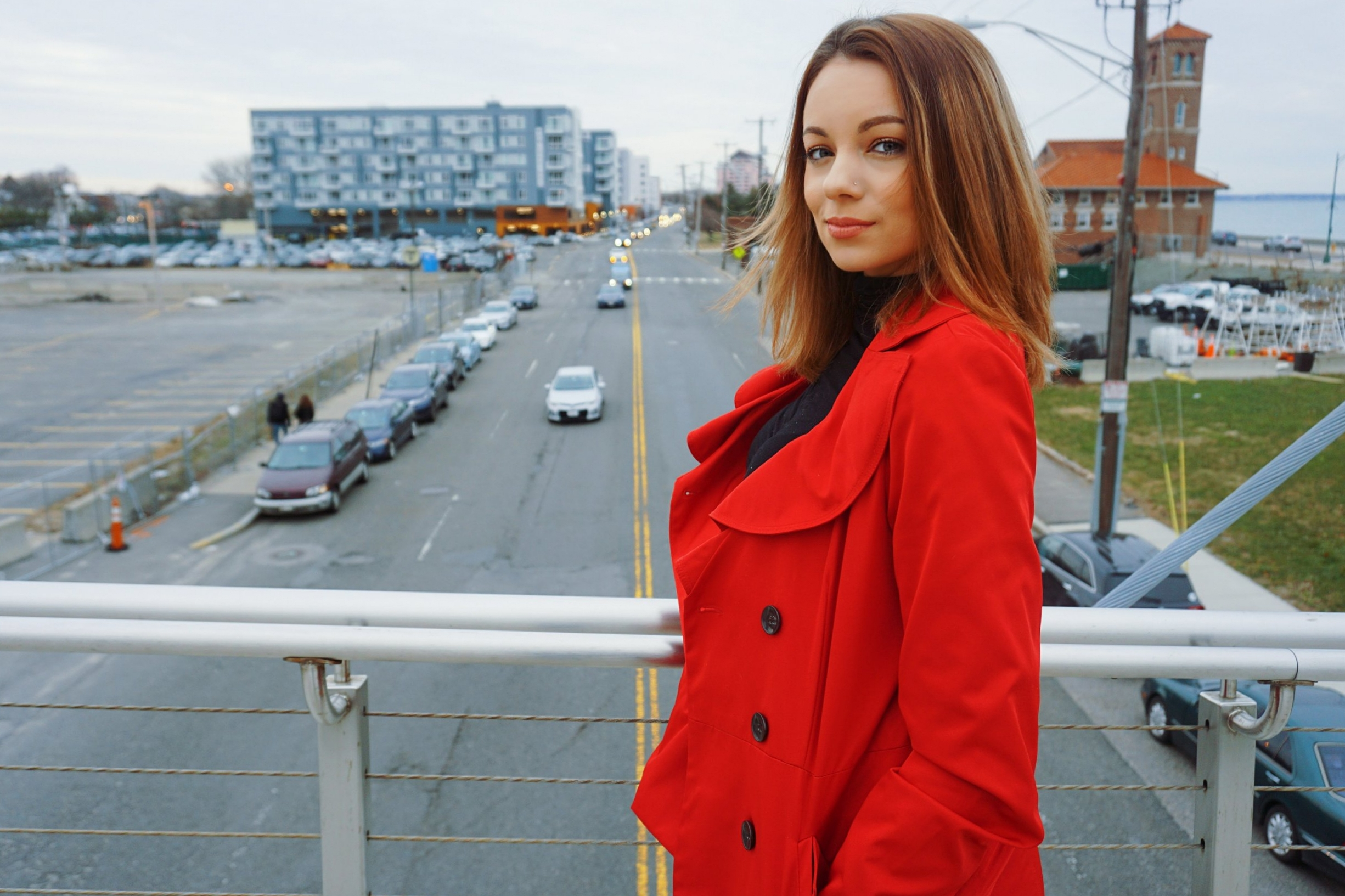 A girl wearing a red playful coat.