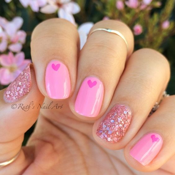 Pink nails with glitter for Valentine's Day.