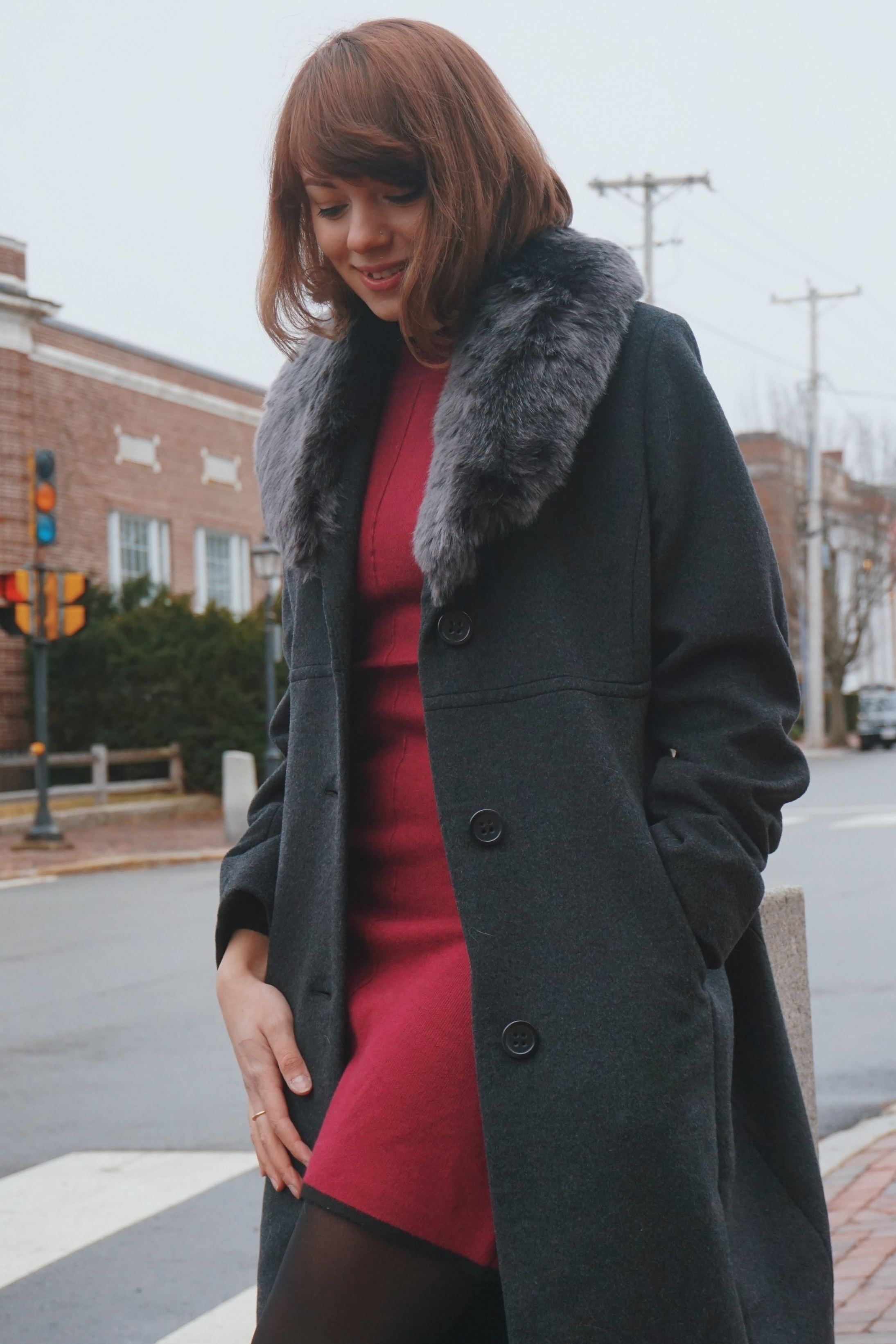 A close-up of a fashion blogger posing in Newburyport.