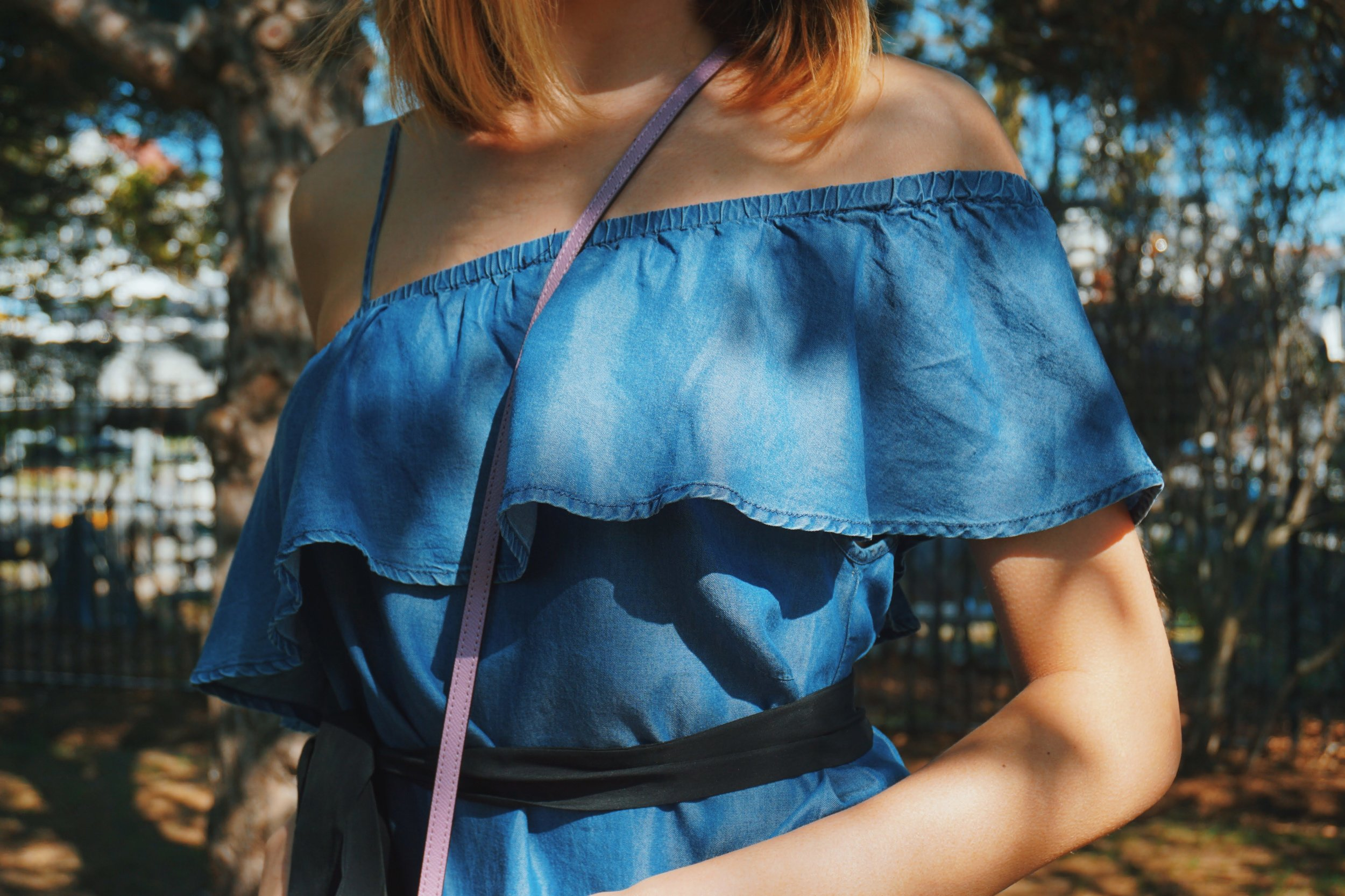 Outfit details: denim one shoulder off dress, black tie on the waist, ruffles on the chest area of the dress.