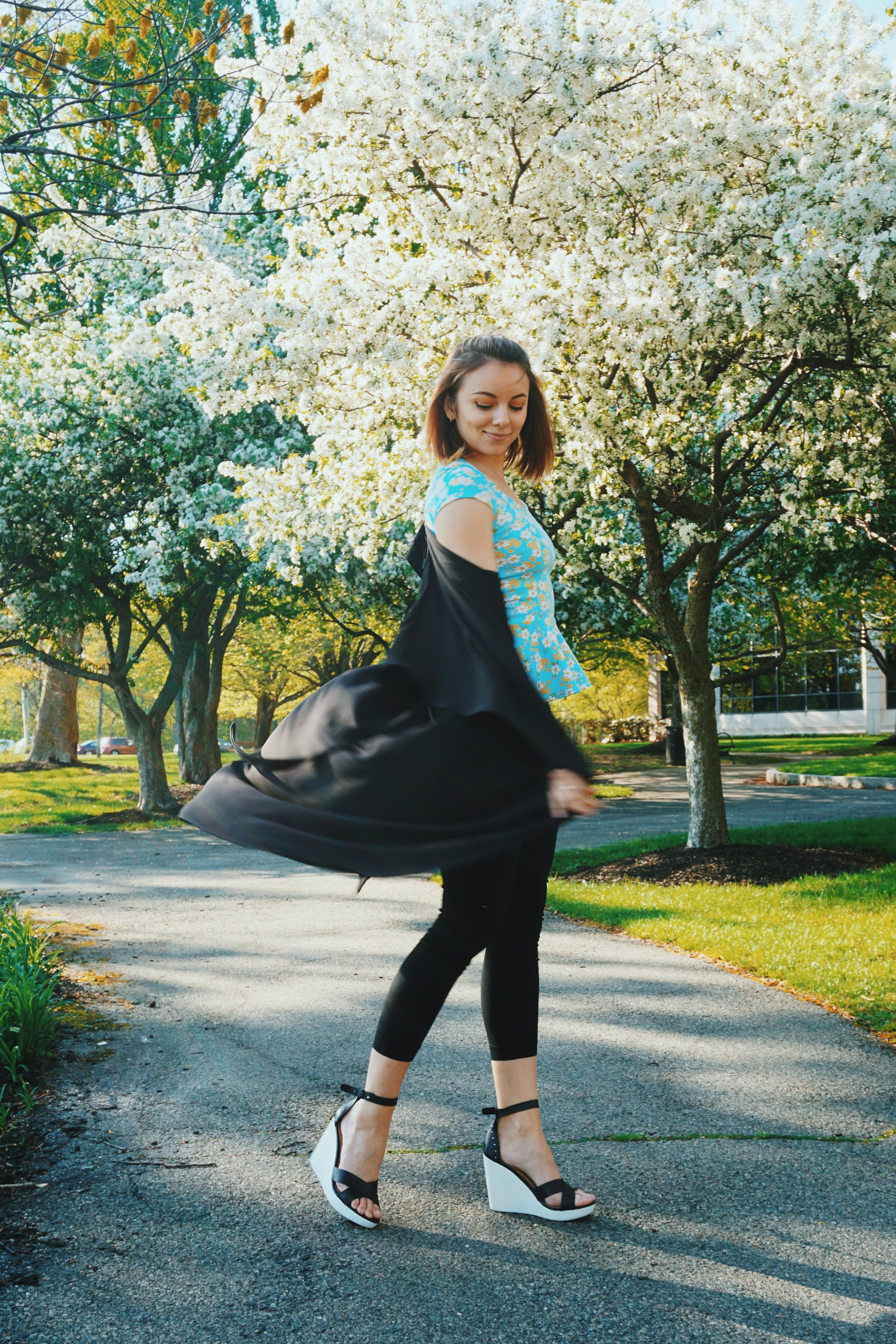 A photo of a fashion blogger twirling in a cute summer outfit.