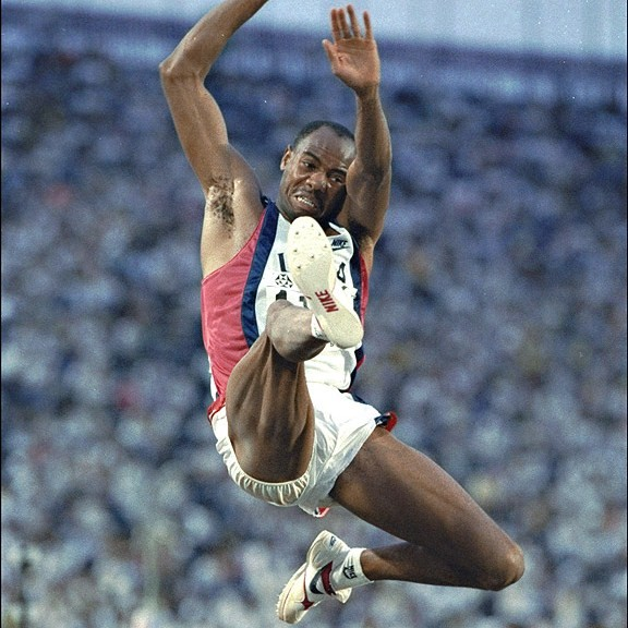 Mike Powell - Personal Record8.95m (29 feet 5 inches)AchievementsWorld Record Holder (1991 - Present)Olympic Athlete (1988, 1992, 1996)2 x Gold Medalist (World Championship)The holder of the long jump world record. He is a two-time world champion in this event and two-time Olympic silver medalist. Former jumps coach at UCLA.